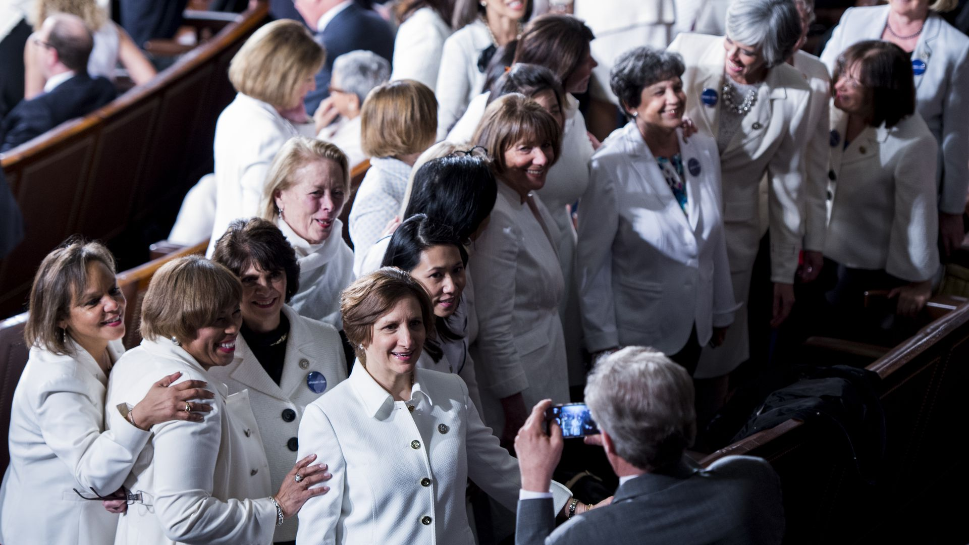Group of Democratic women get their photo taken at President Trump's address to Congress.