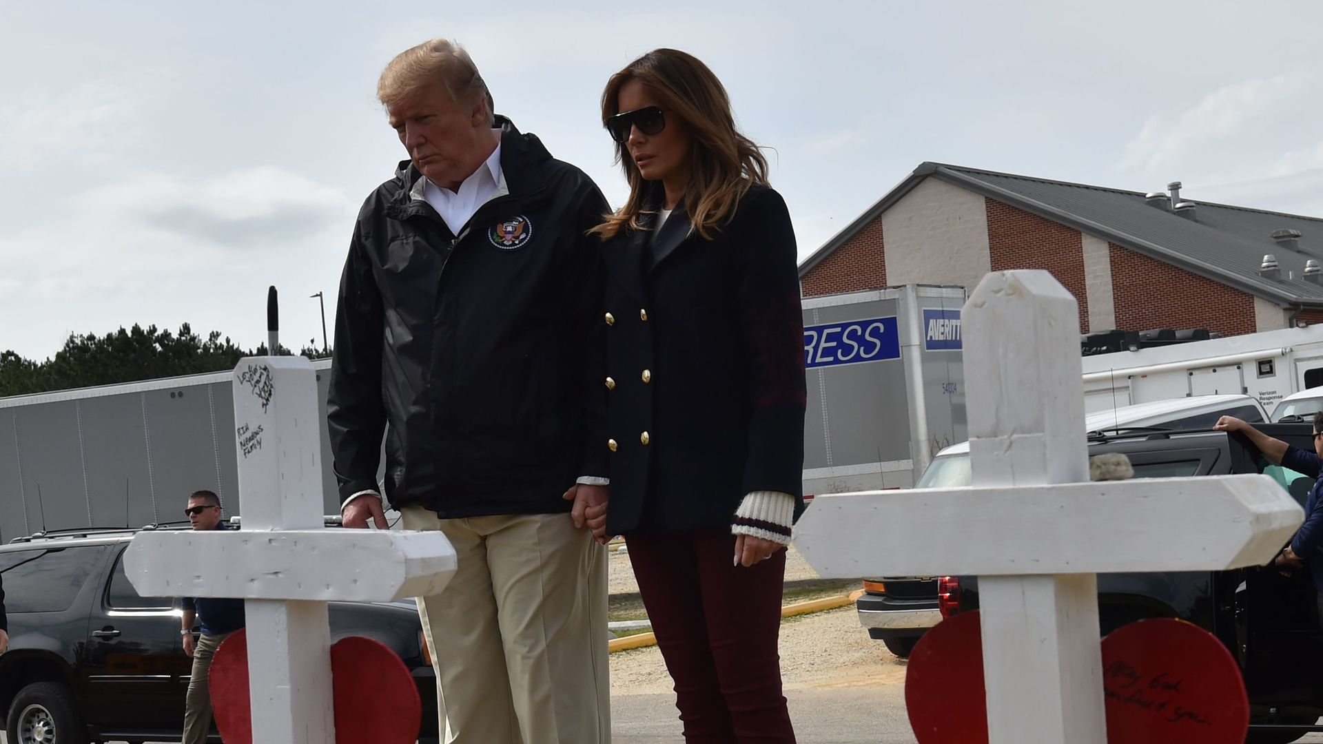 President Trump and Melania Trump view crosses honoring 23 people killed in an Alabama storm.