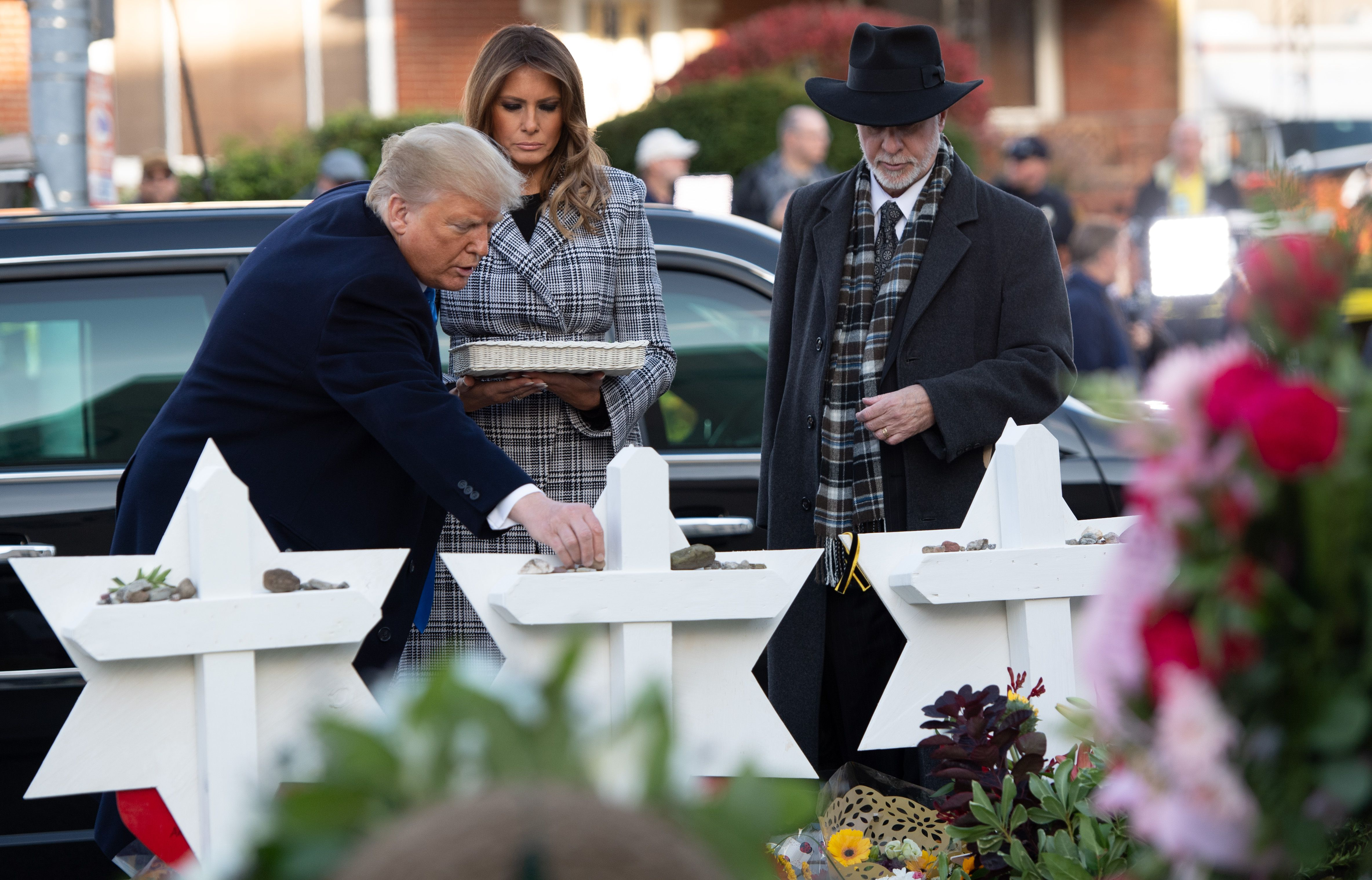 Trump places a stone on a star of david.