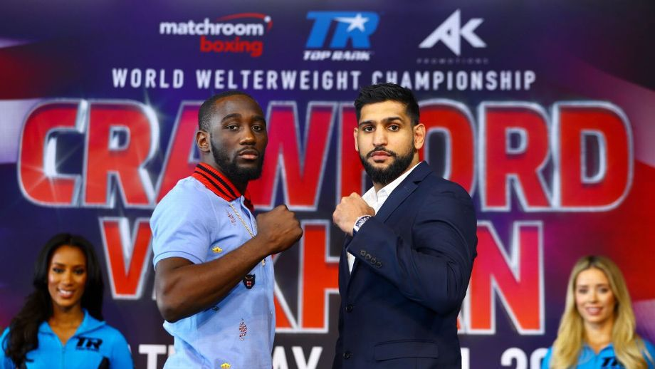 Terence Crawford and Amir Khan facing each other