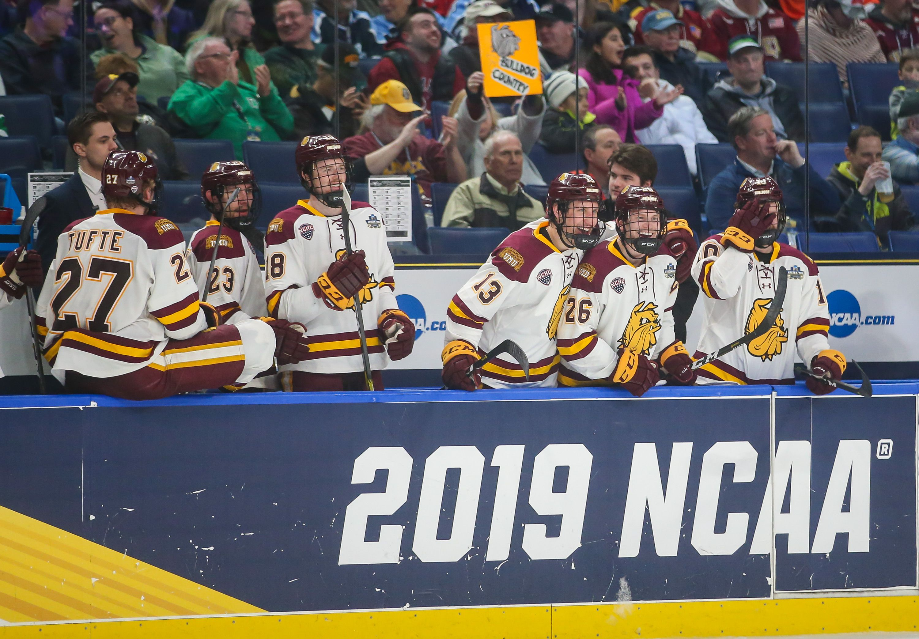 Minnesota Duluth's bench celebrates their victory
