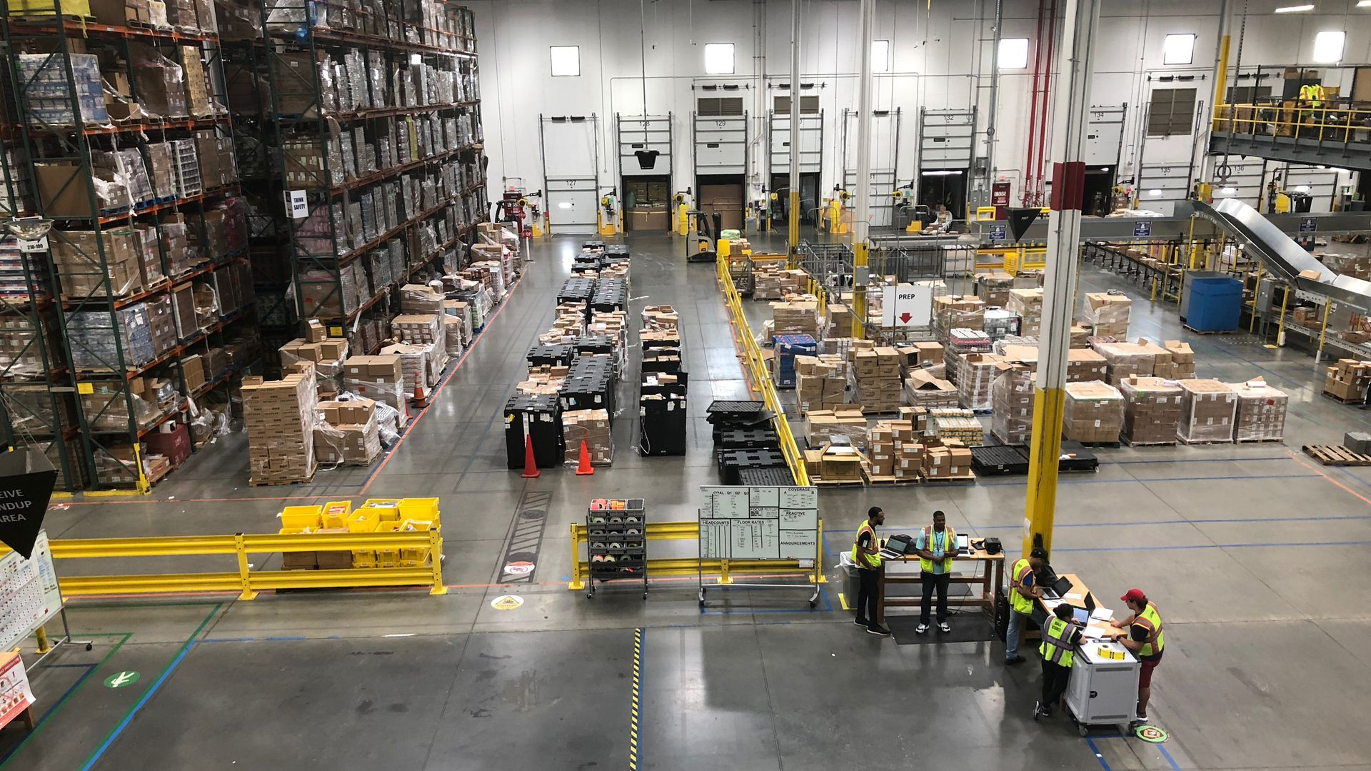 A bird's eye view of a warehouse with packages stacked high