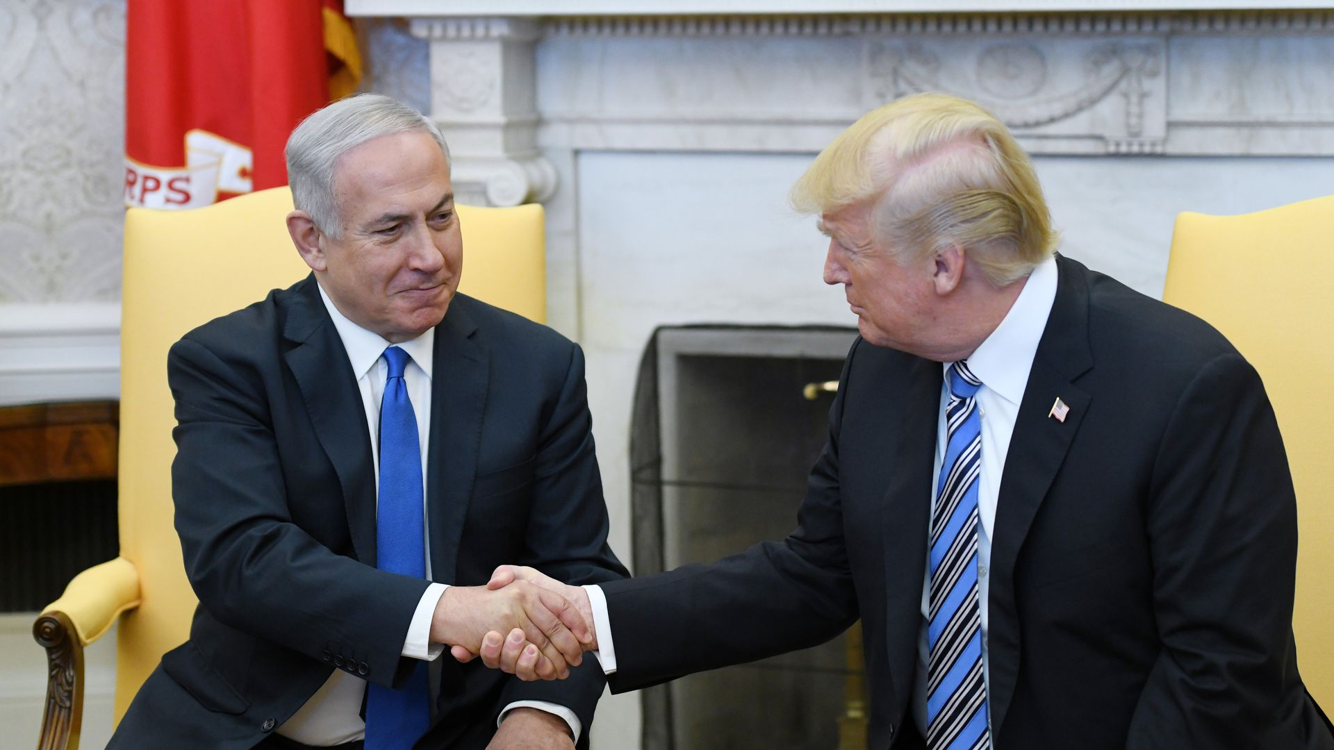 Trump shaking hands with Benjamin Netanyahu