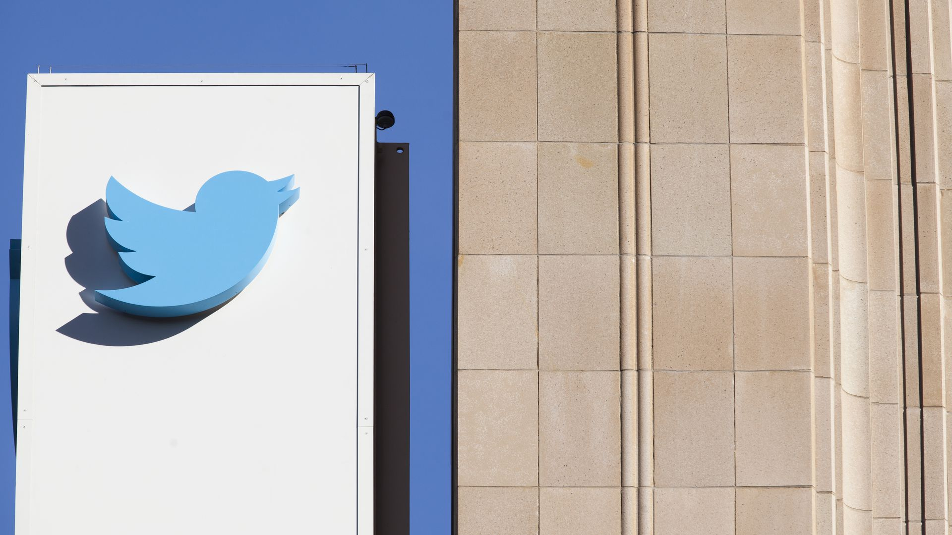 The Twitter logo on a sign outside of company HQ