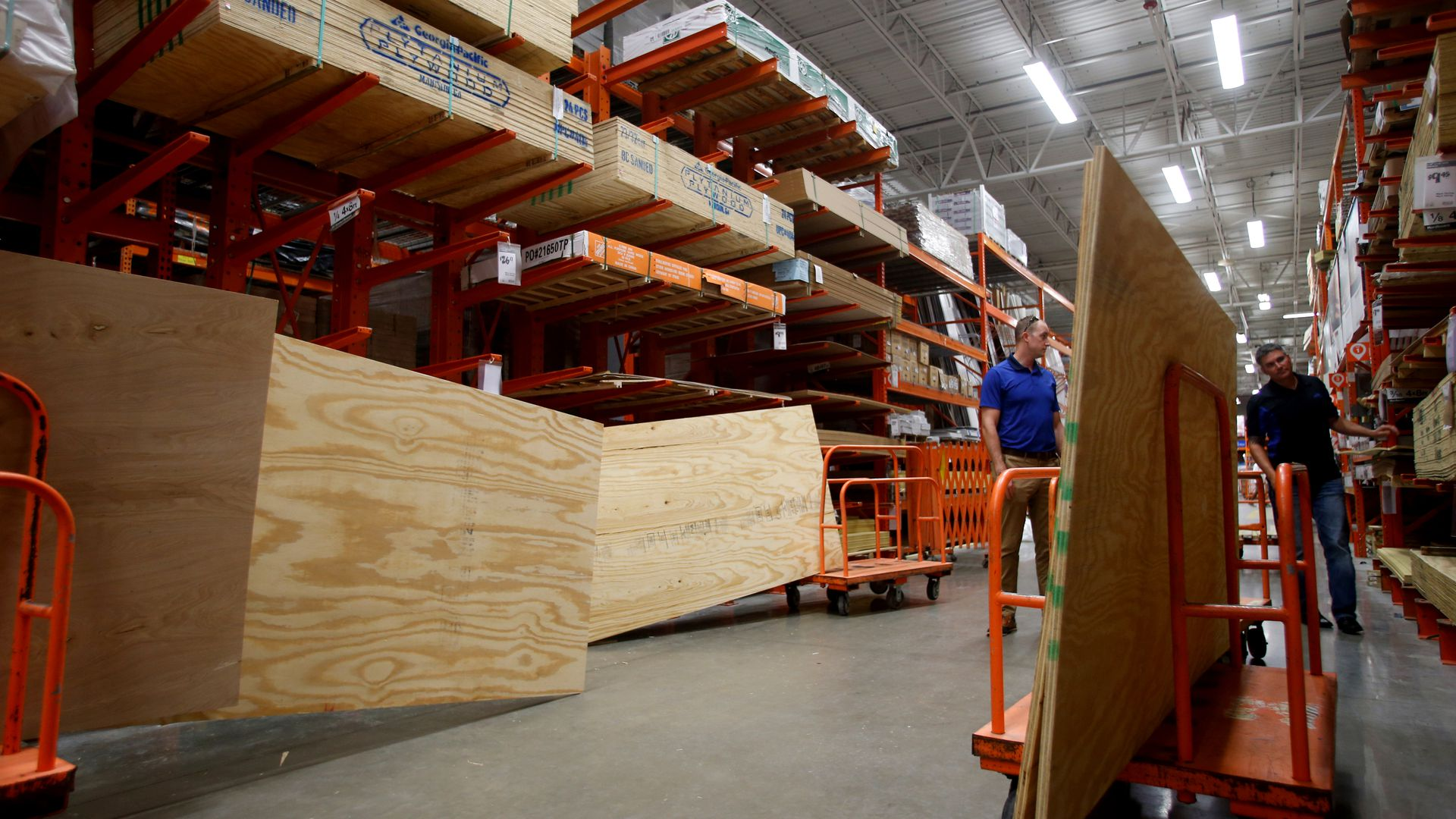 Home depot shelves with stacks of plywood