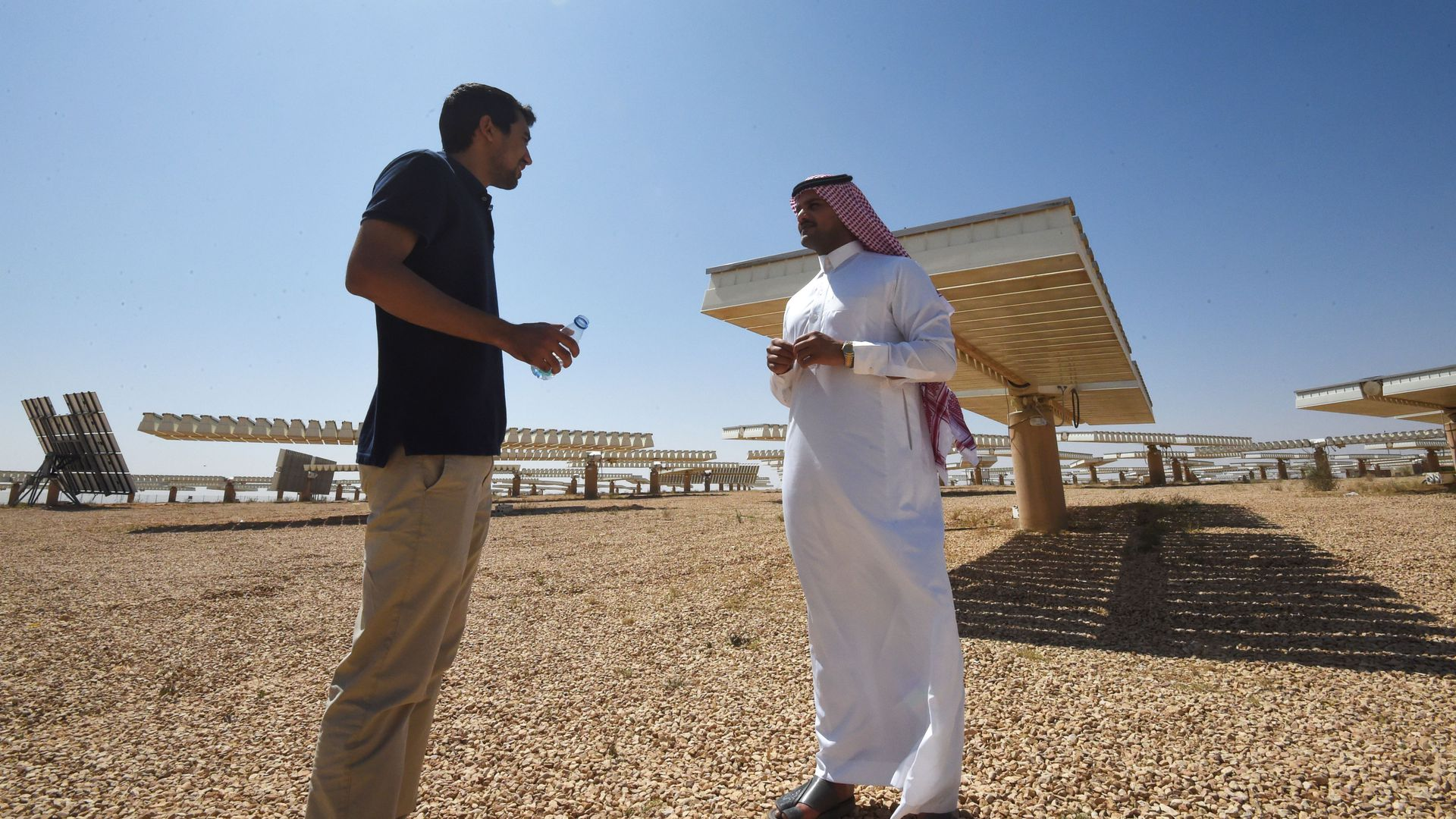 A Saudi man speaks to a journalist at a solar plant in Uyayna, north of Riyadh, on March 29, 2018.