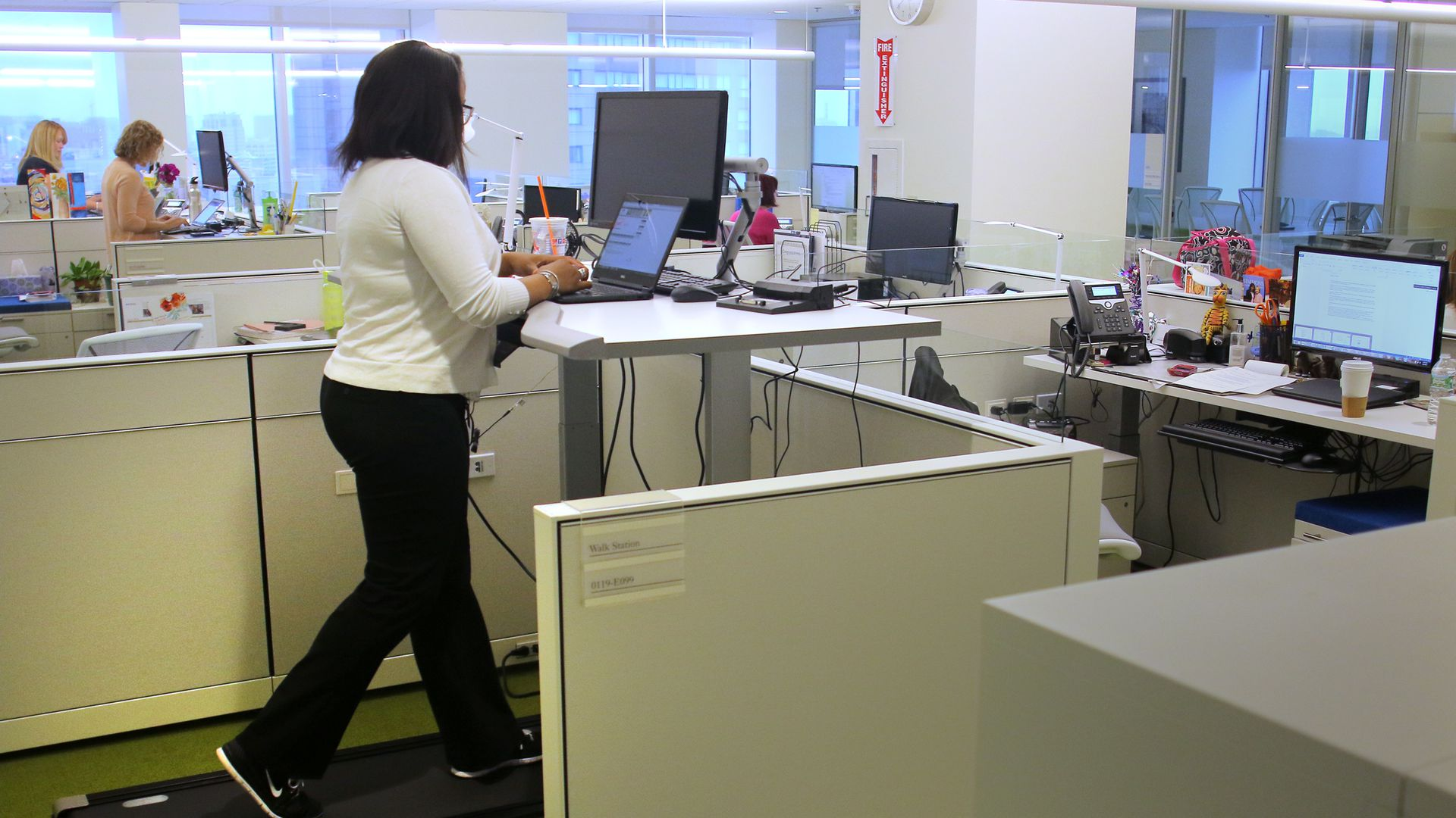 A woman on a treadmill at work.