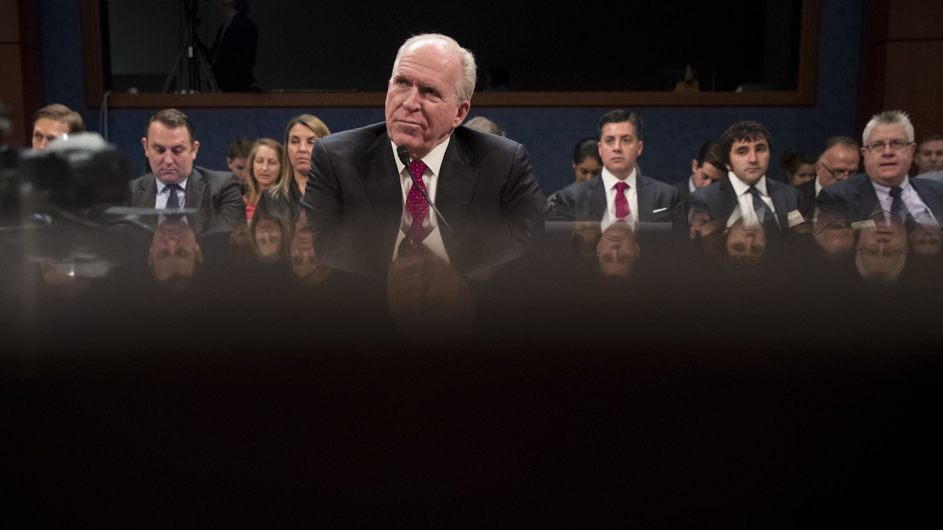 Former CIA Director John Brennan testifying before the House Intelligence Committee.