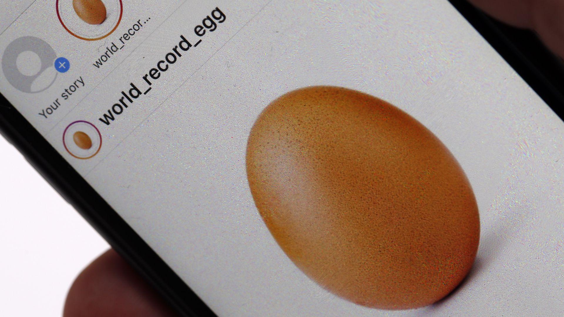 In this illustration photo, a mobile phone shows the image of an egg which was posted on the Instagram social network on January 14, 2019 in Paris, France