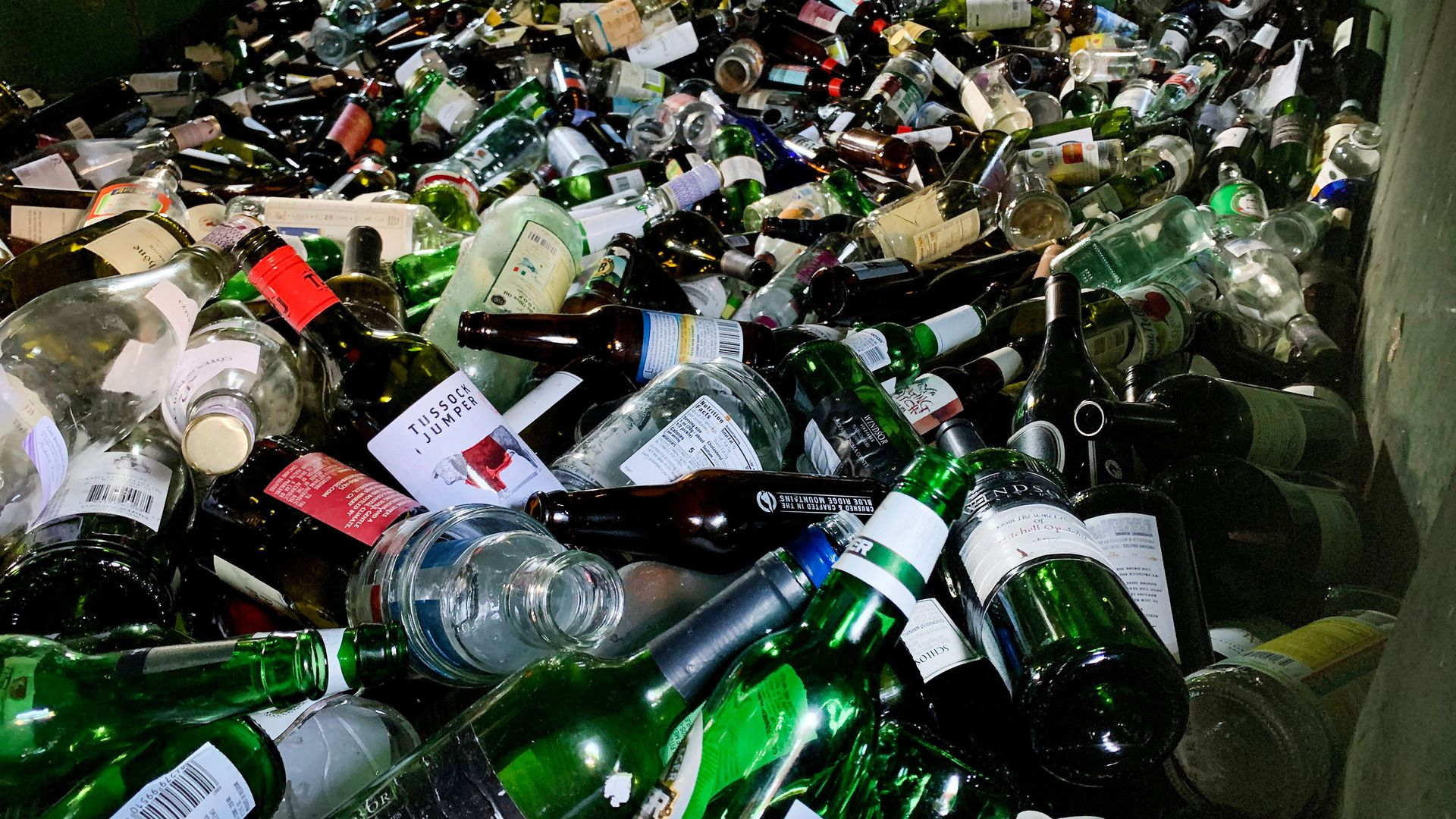 Empty glass bottles including those from wine and beer