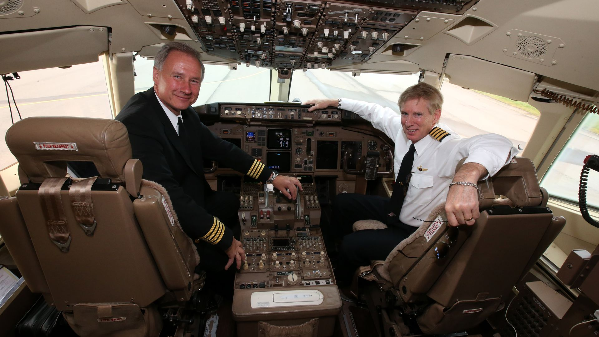Pilots Captains John Dunkin (left) and Jay Galpin after flying Businessman American tycoon Donald Trump's private jet. (Photo by Andrew Milligan/PA Images via Getty Images)