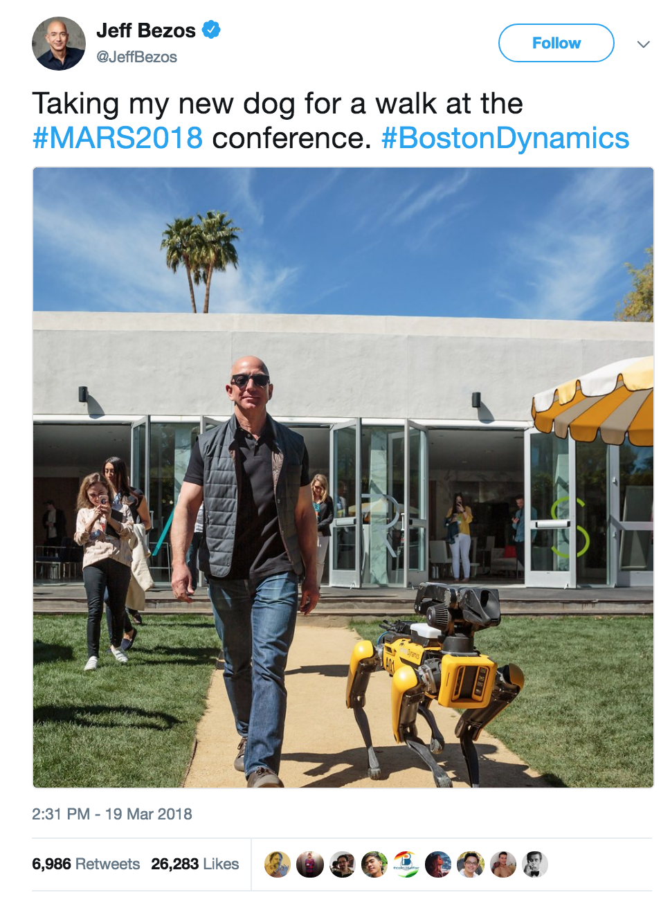 Jeff Bezos tweet of him walking with dog robot