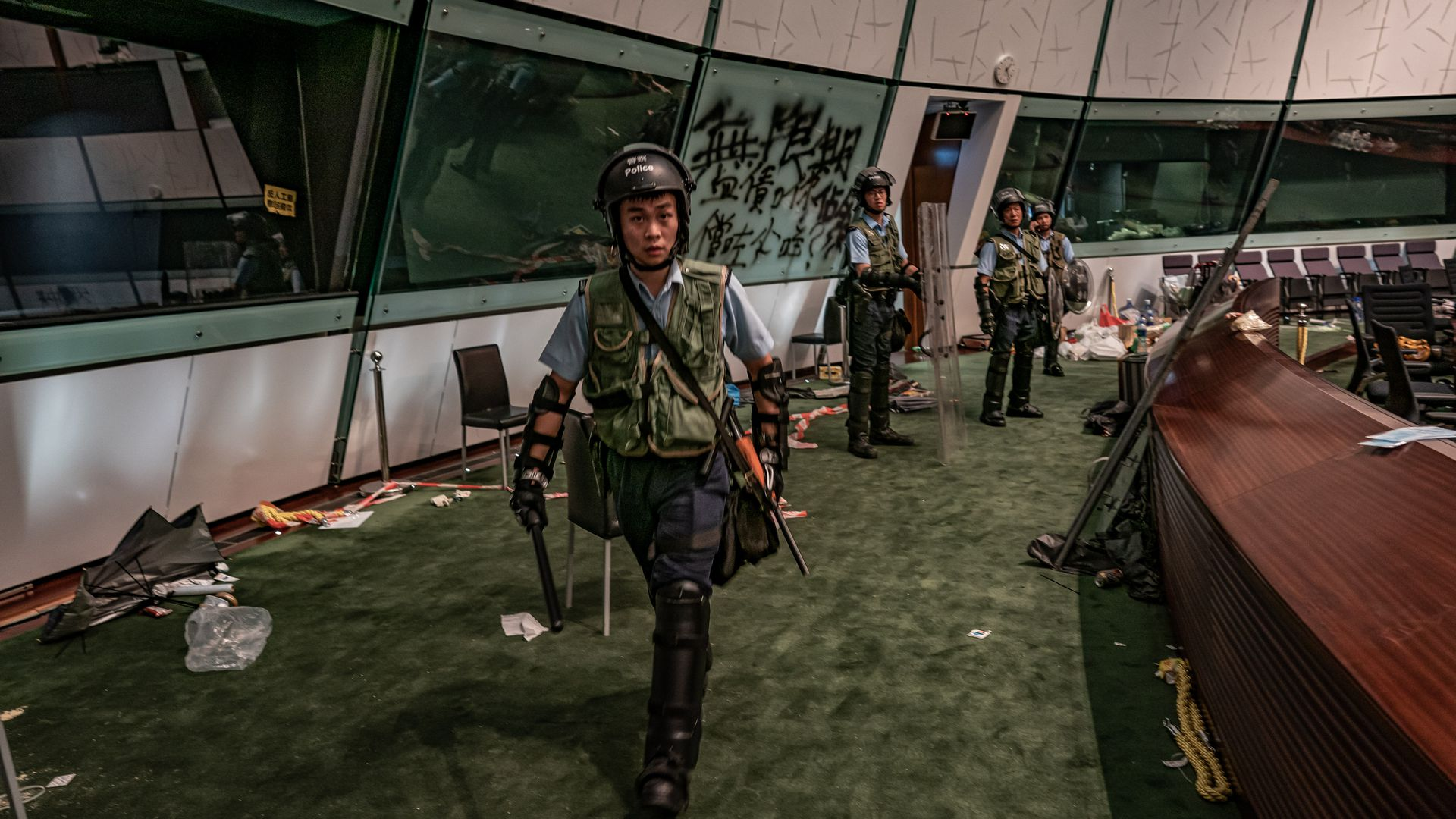 Riot police patrol inside the Legislative Council building.