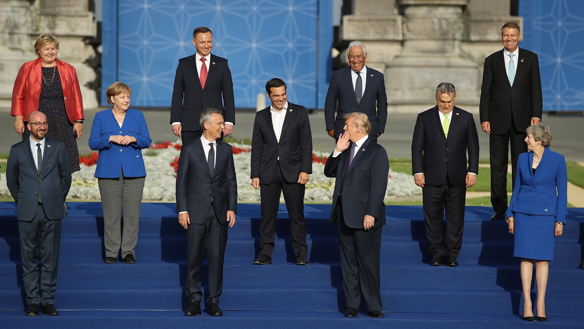 Trump stands for a photo with NATO leaders on steps