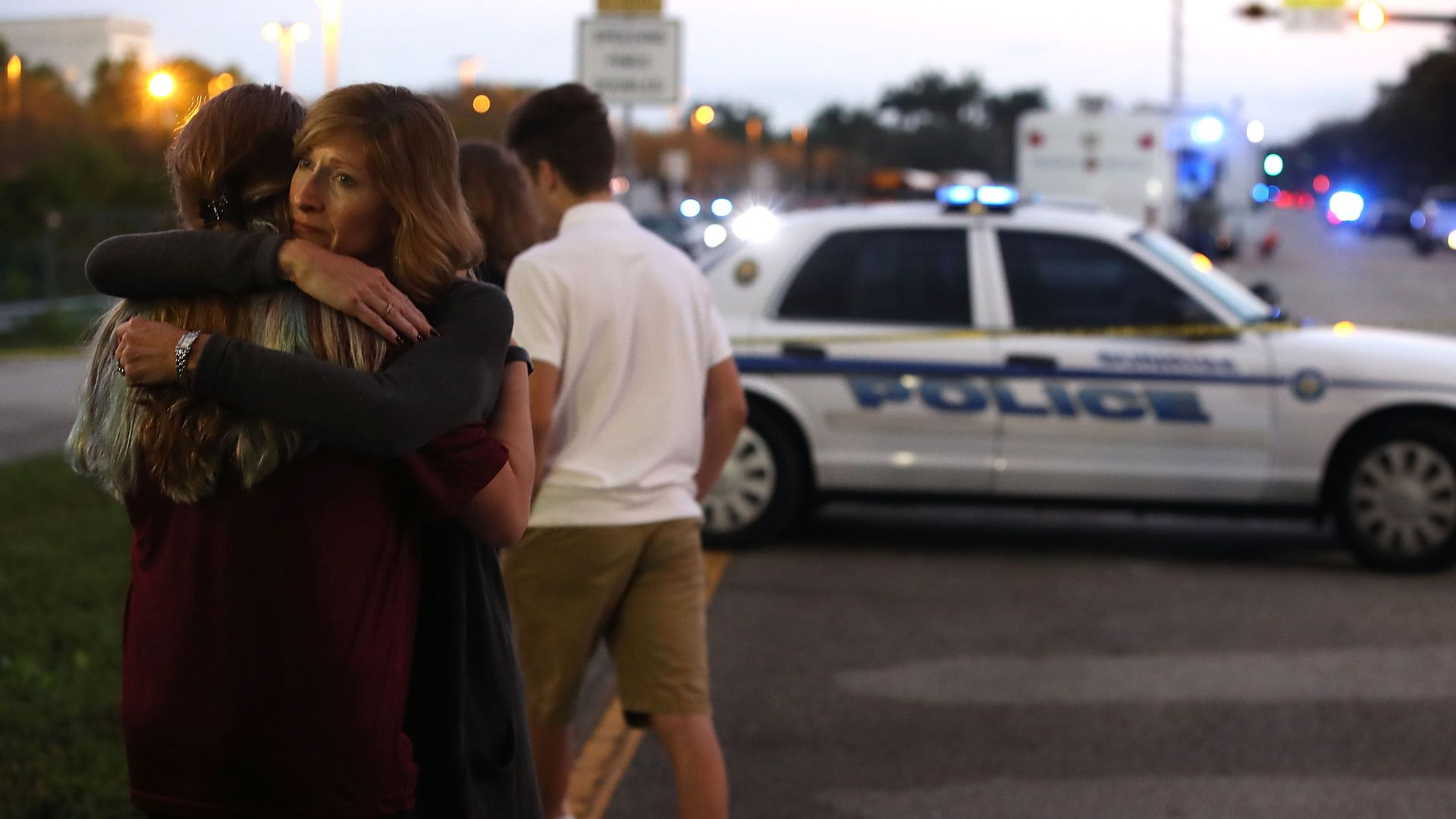 Woman hugs girl after Parkland shooting