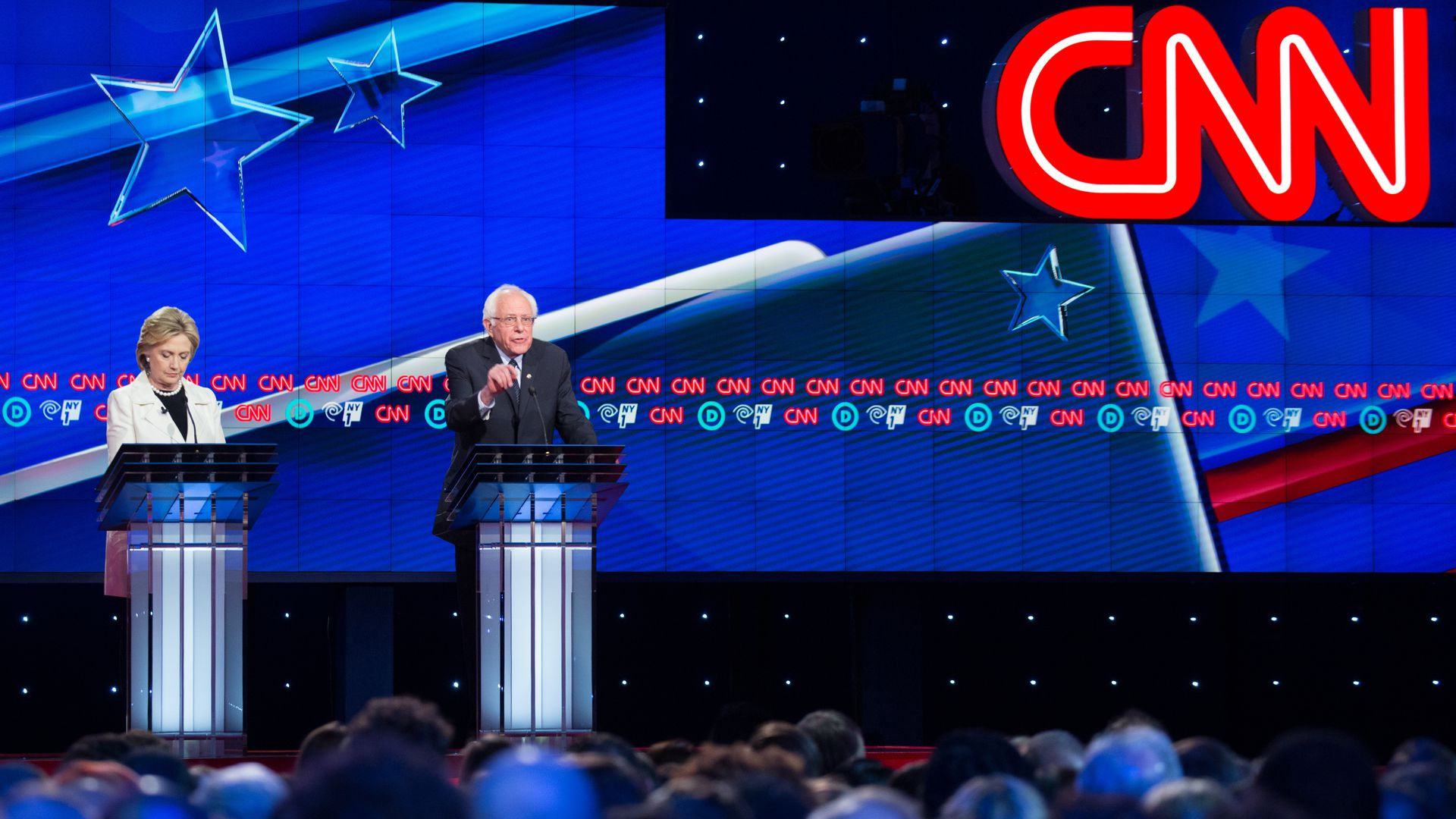 Hillary Clinton and Bernie Sanders during the 2016 Democratic candidate debates hosted by CNN