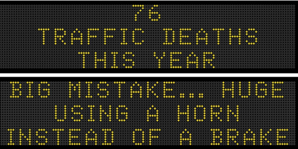 Two messages encourage safe driving on Iowa DOT highway boards.