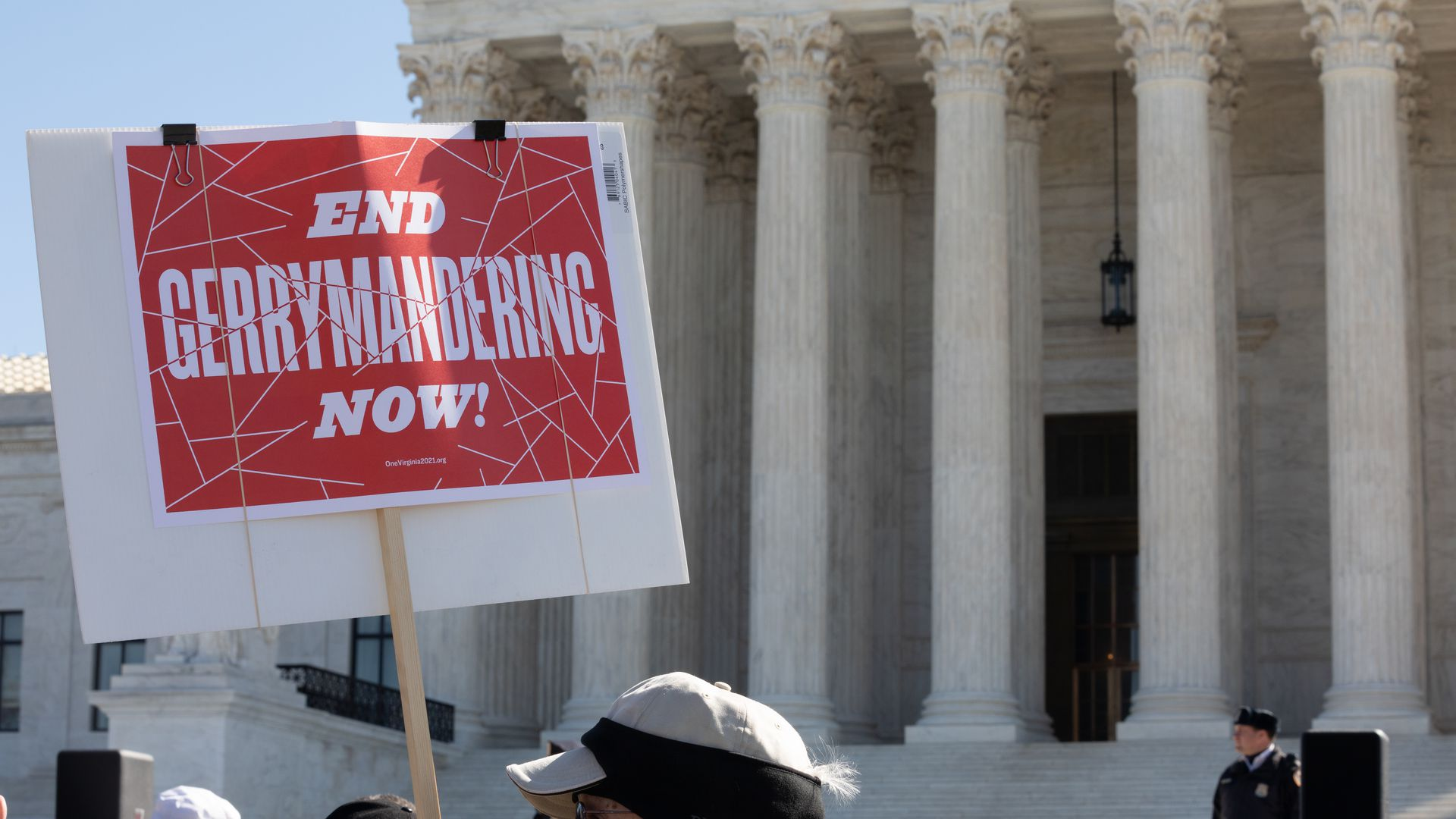 "A protester waves a ""Stop gerrymandering now"" sign outside the Supreme Court"