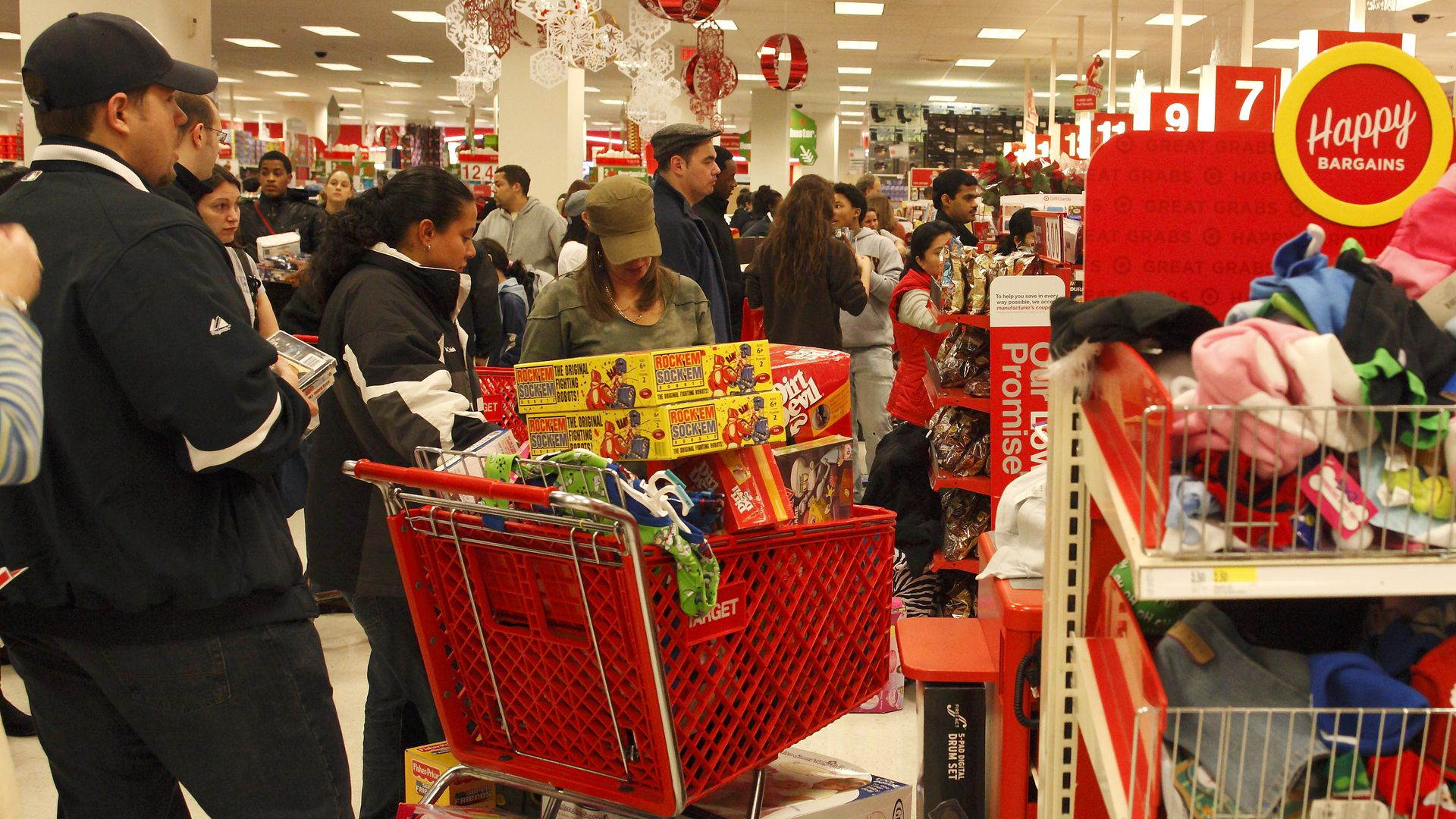 Shoppers, in a Target store, take advantage of the steep discounts offered on Black Friday, the most important shopping day of the year for retailers.