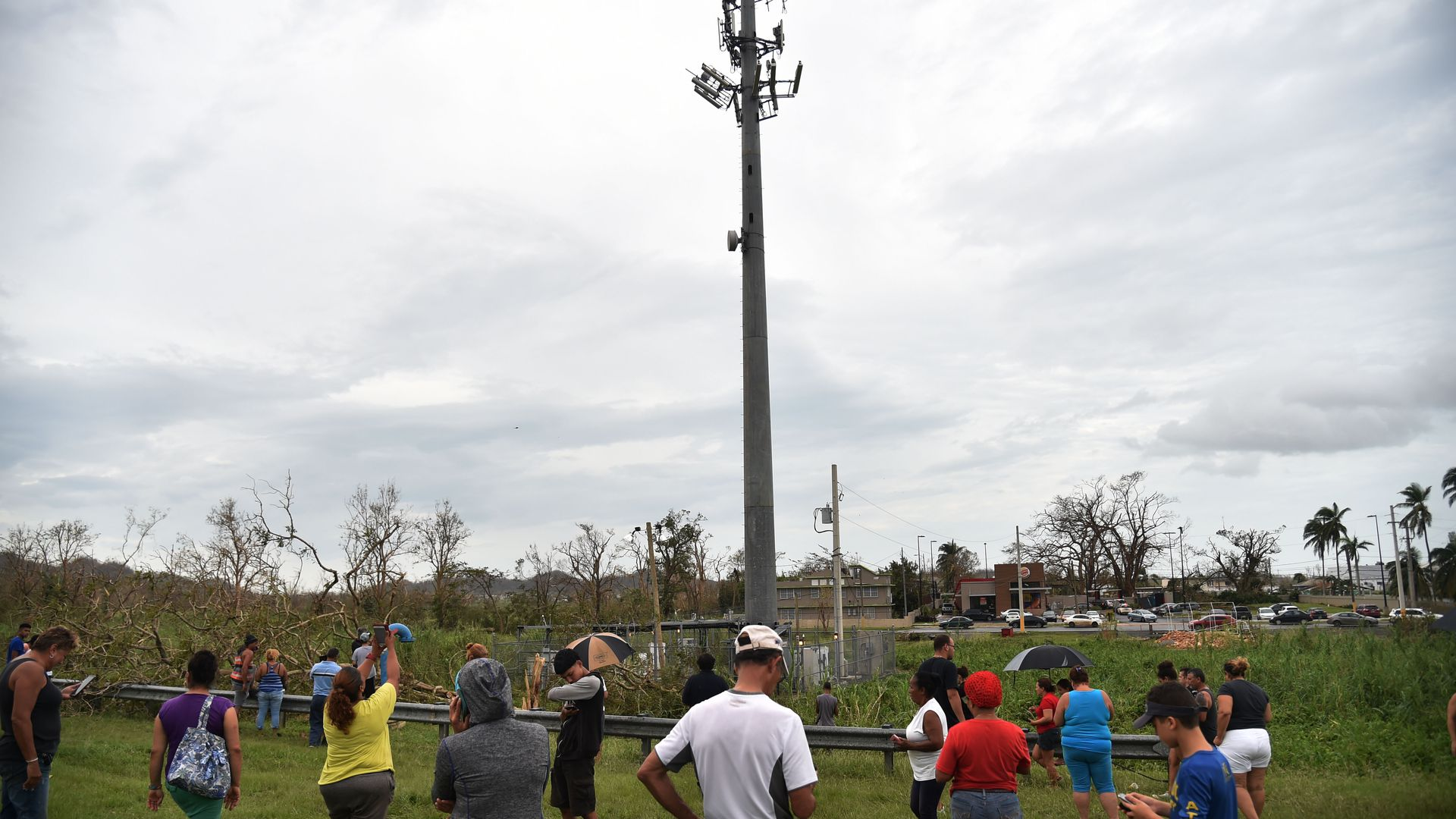 People try to get a cellphone signal in Puerto Rico after Hurricane Maria took down telecommunications networks
