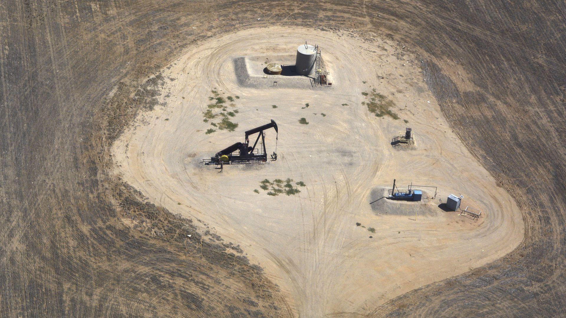 Oil and gas wells on Denver International Airport property as seen from a passenger plane landing at the airport in Denver, Colorado.