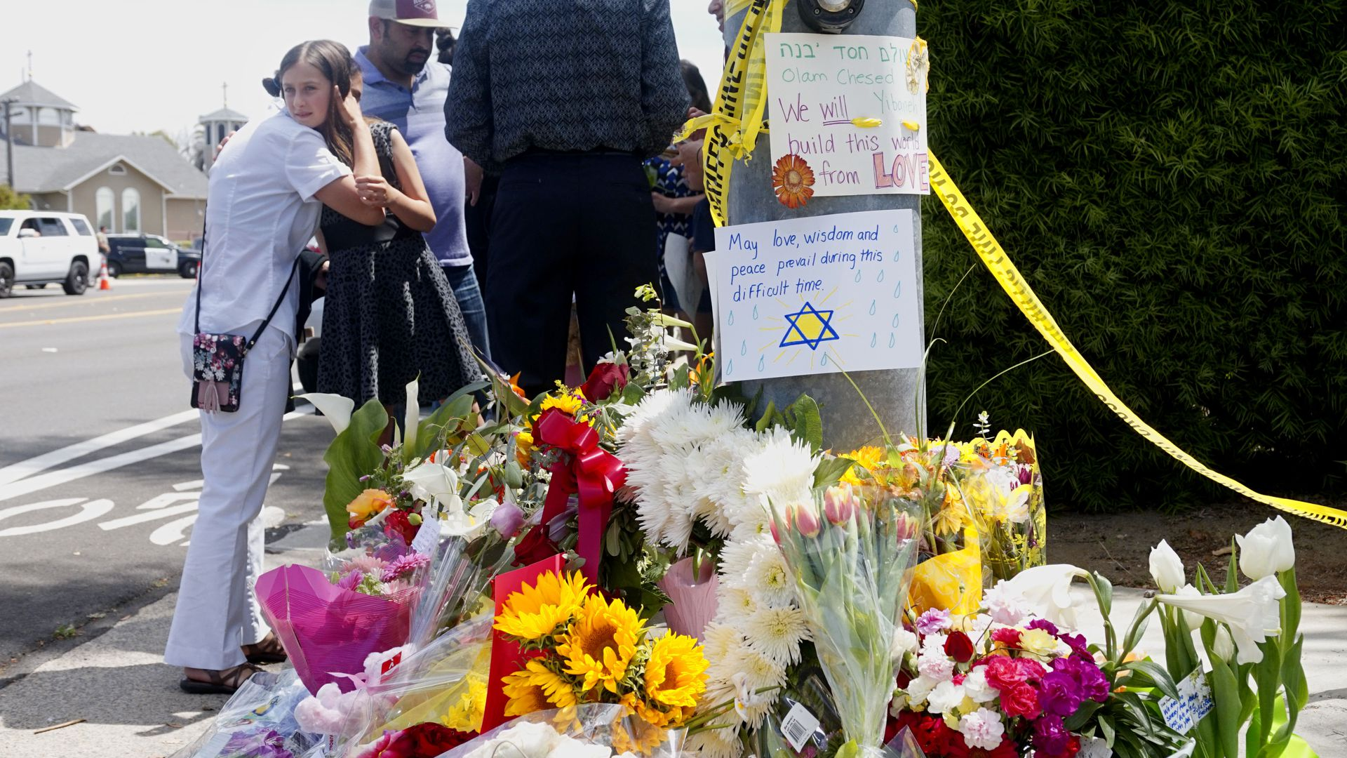 Mourners beside tributes at Chabad of Poway Synagogue in California.