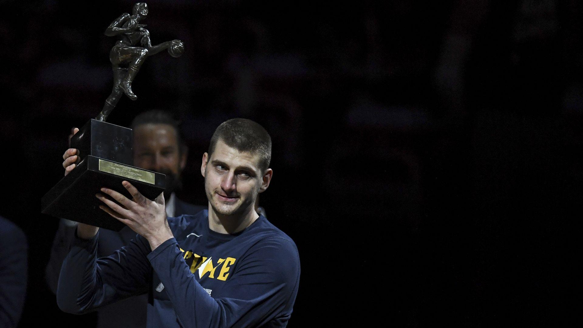Nikola Jokic of the Denver Nuggets hoists his MVP trophy in June.