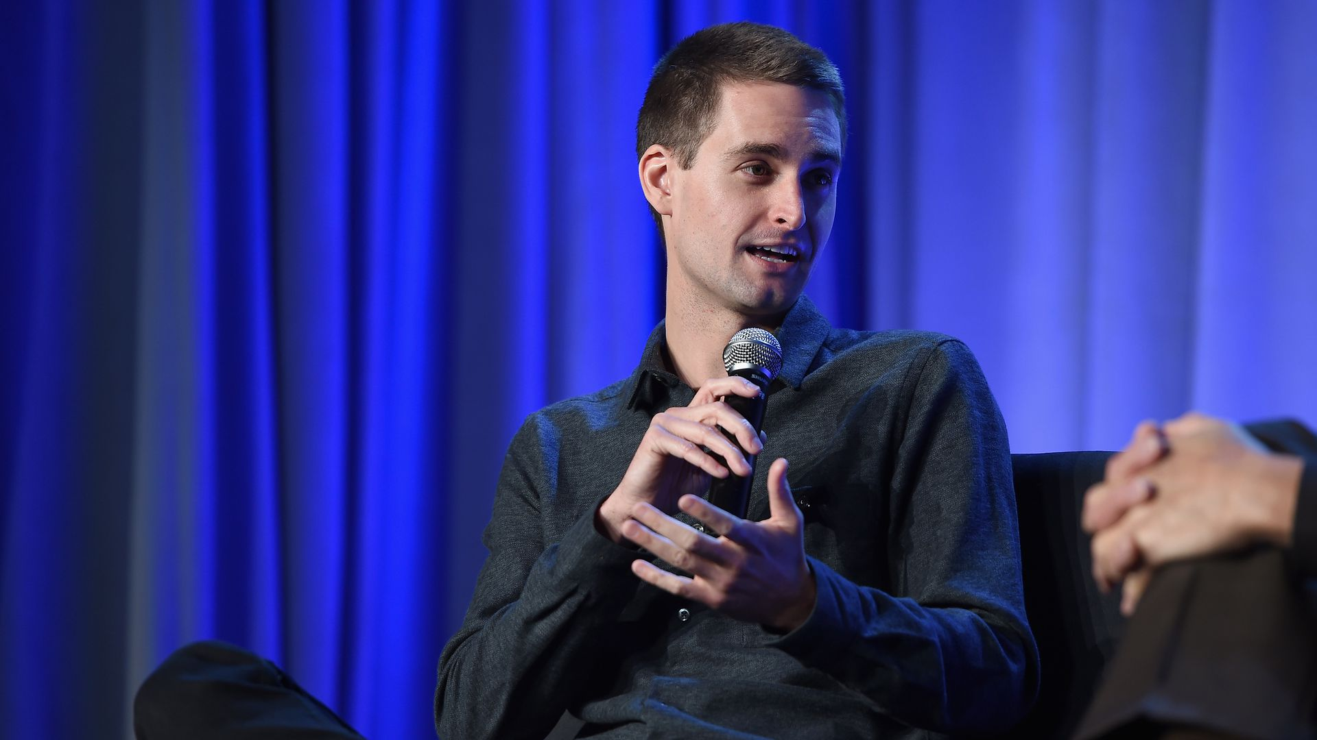 CEO and co-founder of Snapchat Evan Spiegel speaking onstage.