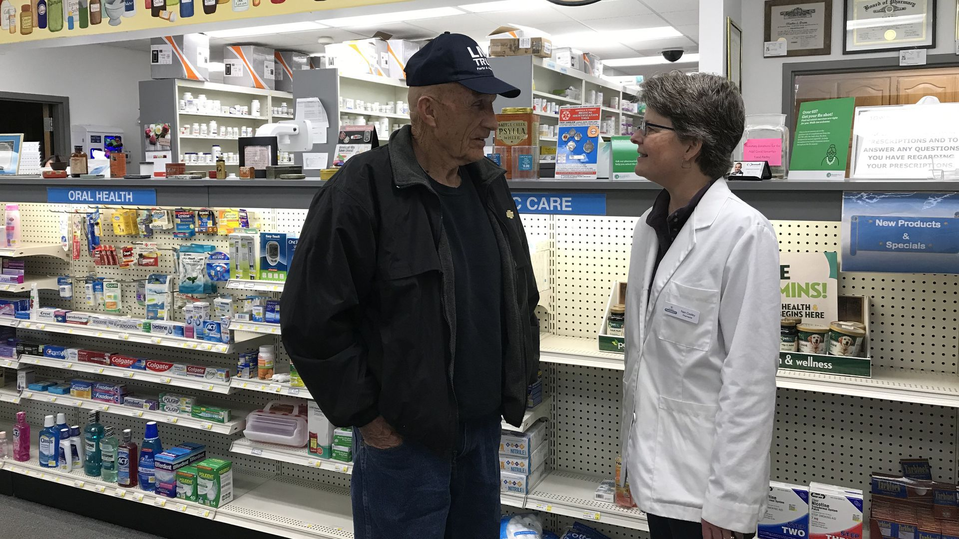 Picture of a man talking to a pharmacist