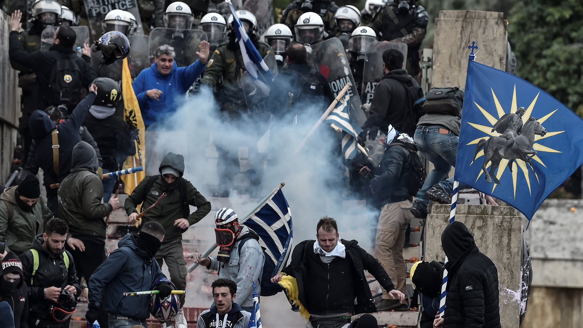 Protesters clash with riot police in Athens on Sunday during a demonstration against the agreement to rename neighbouring country Macedonia as the Republic of North Macedonia.