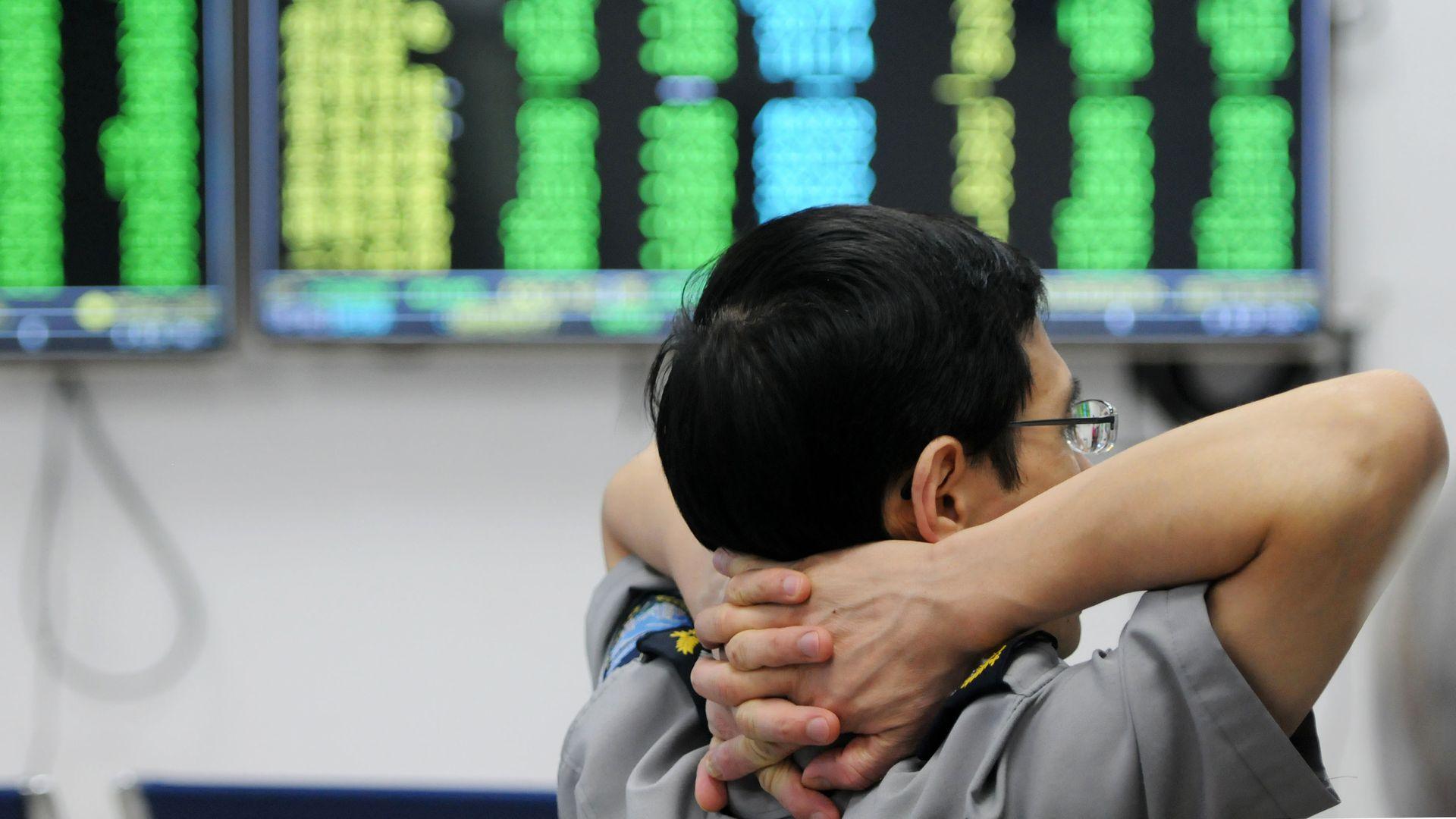 A security guard watching China stocks plummet
