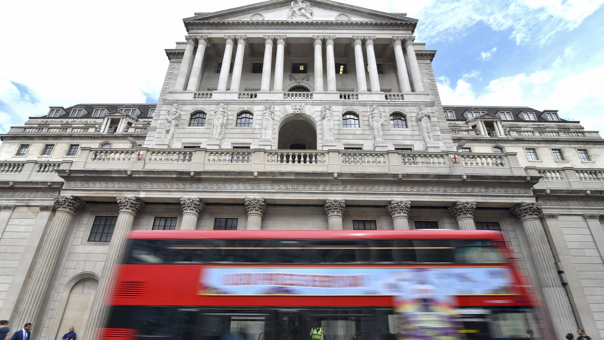 Bank of England with a double-decker zooming by
