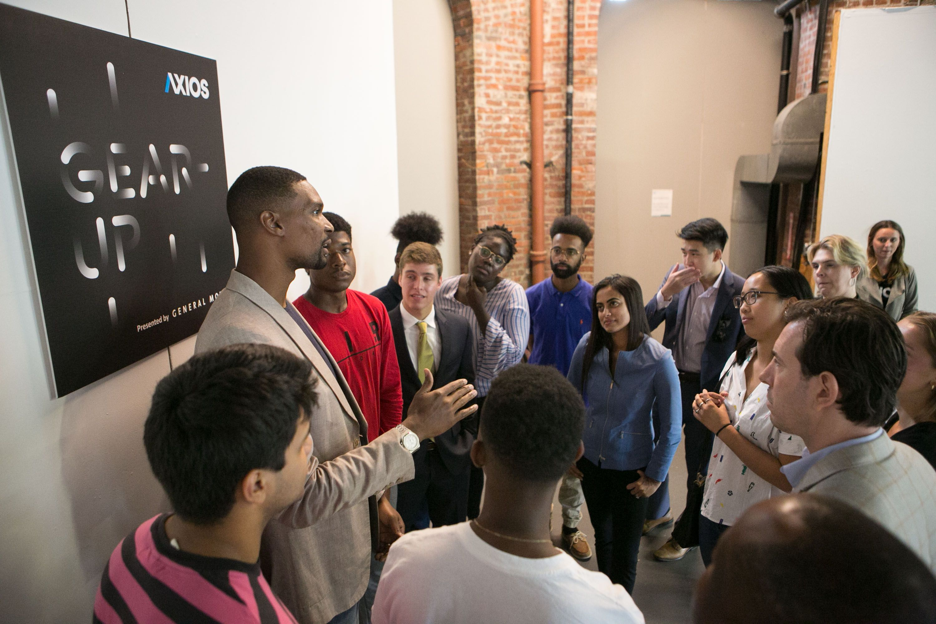 Chris Bosh talking to college students during a post-event meet and greet.