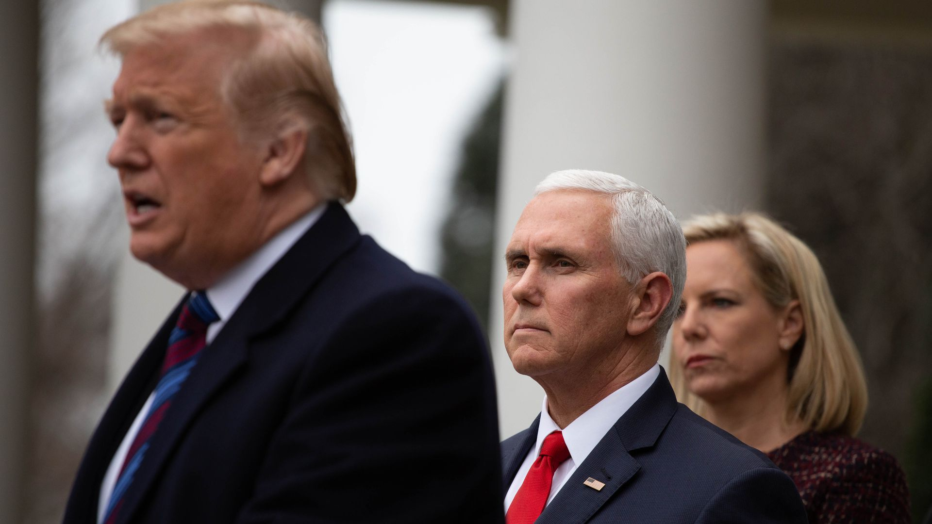 Vice President Mike Pence stands behind President Trump.