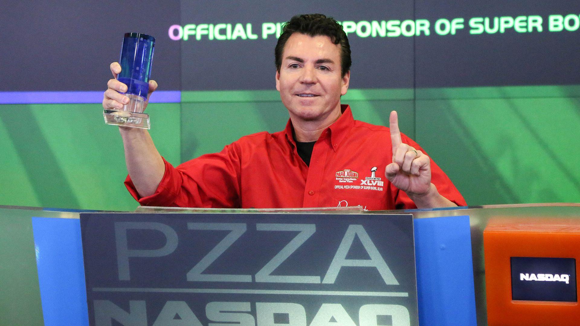 John Schnatter holding a trophy
