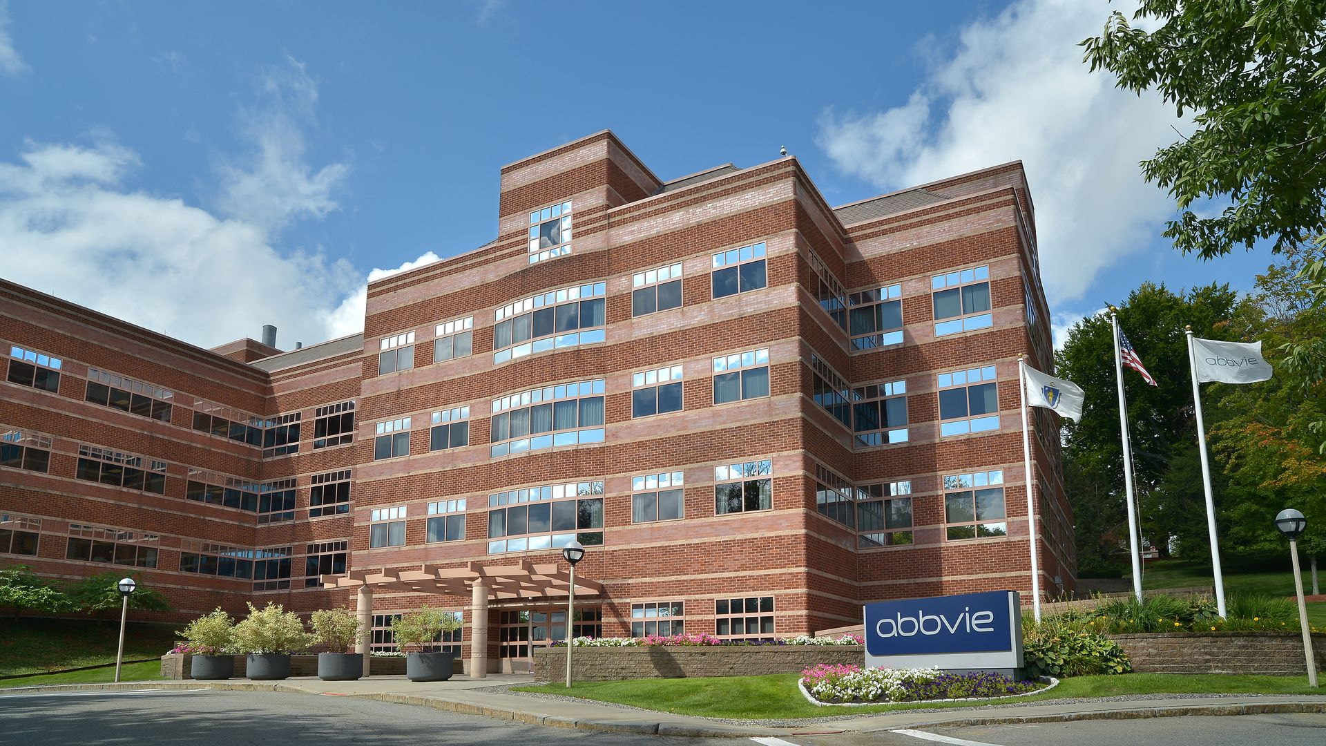 Multi-story AbbVie building with flags outside