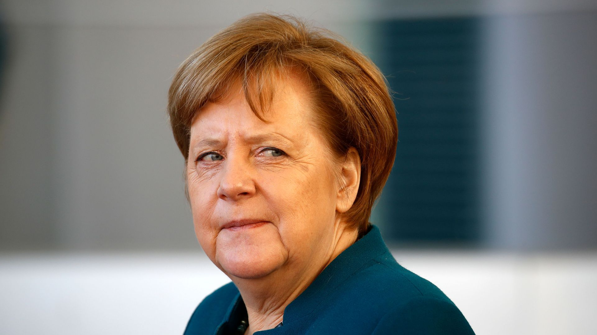 Angela Merkel looks skeptical.