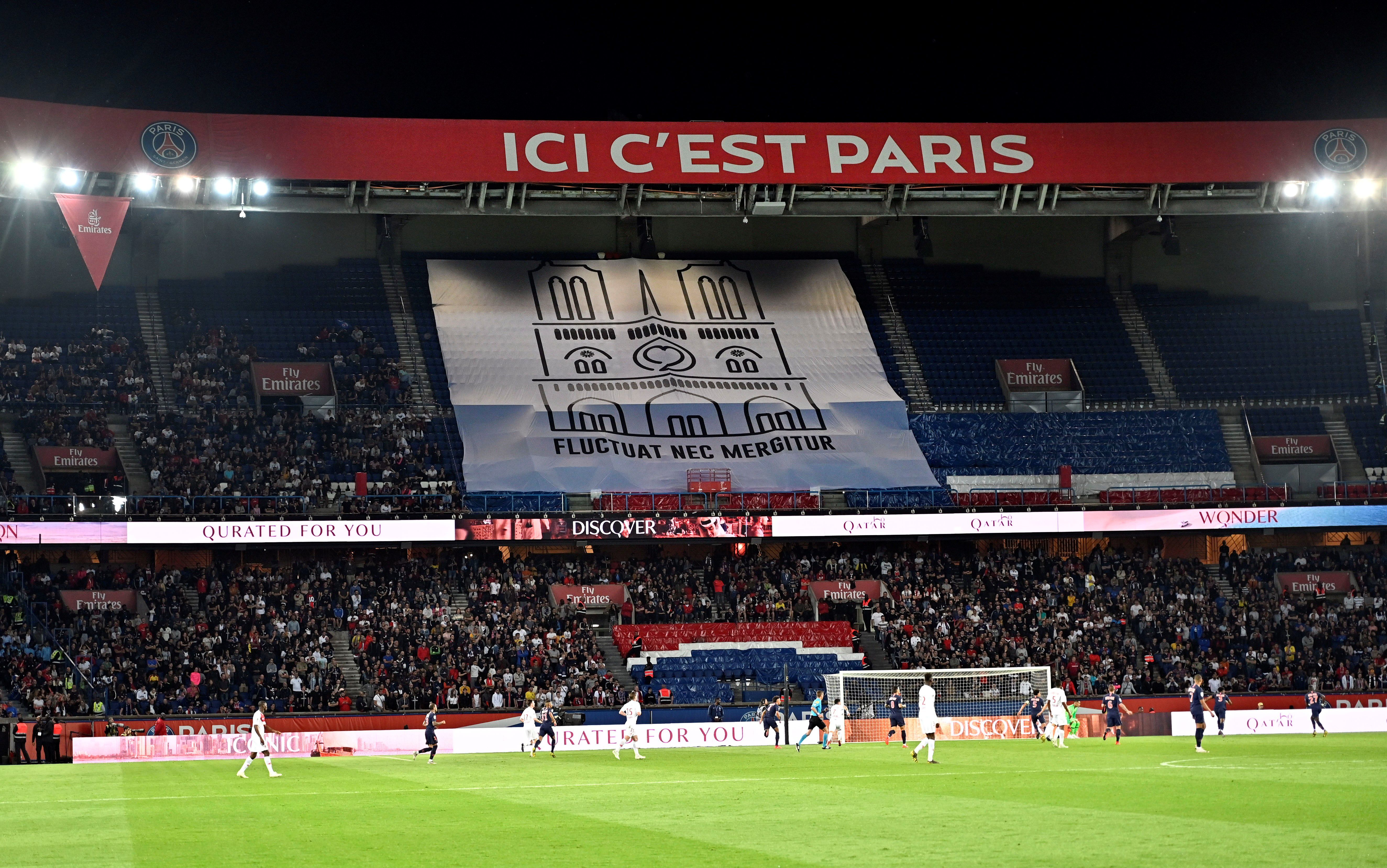 A banner showing a drawing of Notre Dame cathedral is displayed during PSG's game
