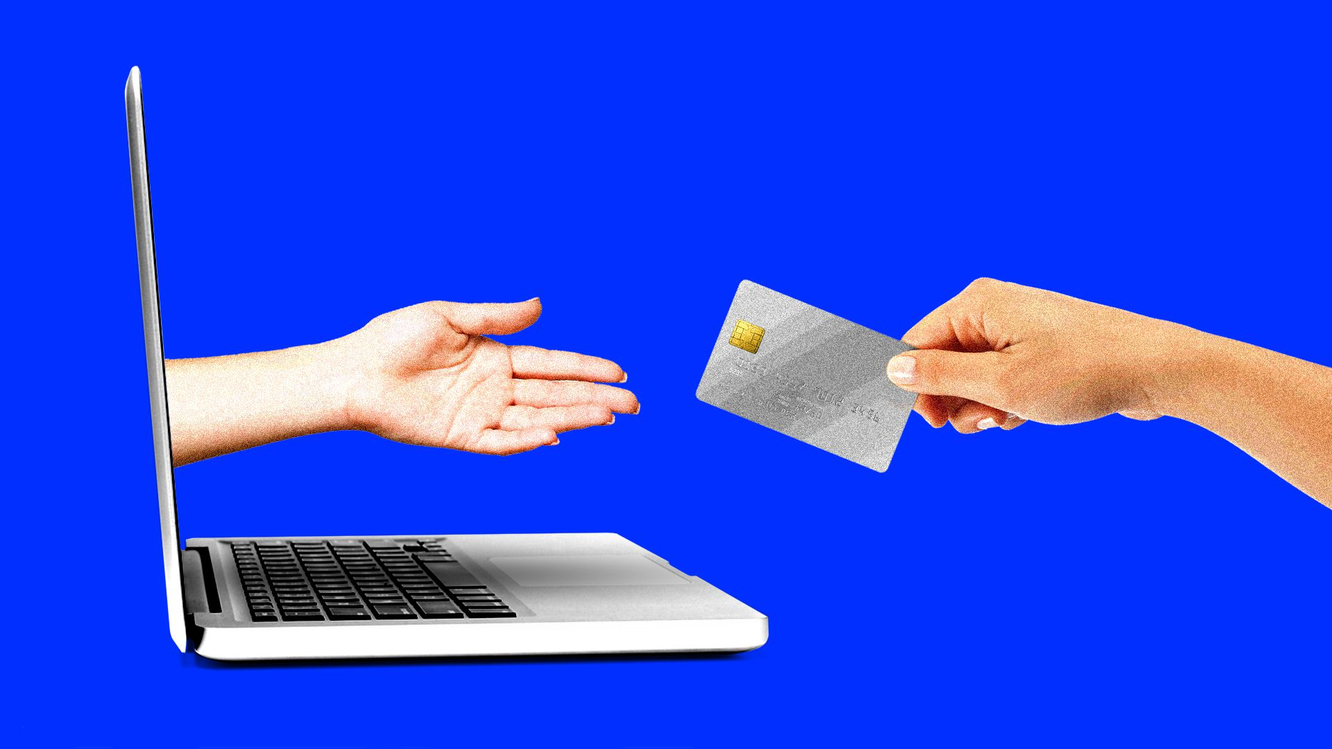 A hand extending from a laptop screen reaches for a credit card