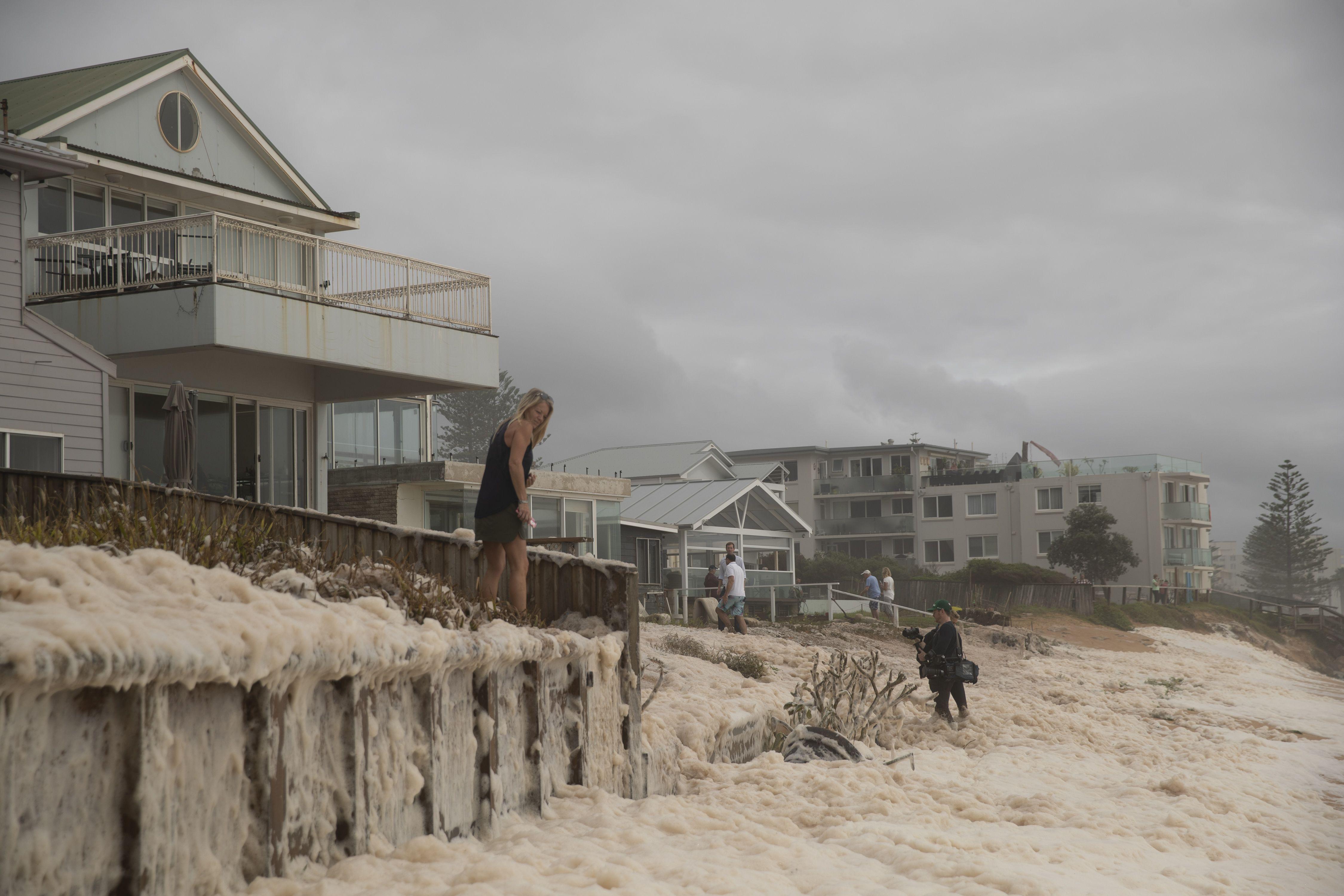 In photos: Australia's fire-ravaged east coast hit by heavy rain and floods - Axios