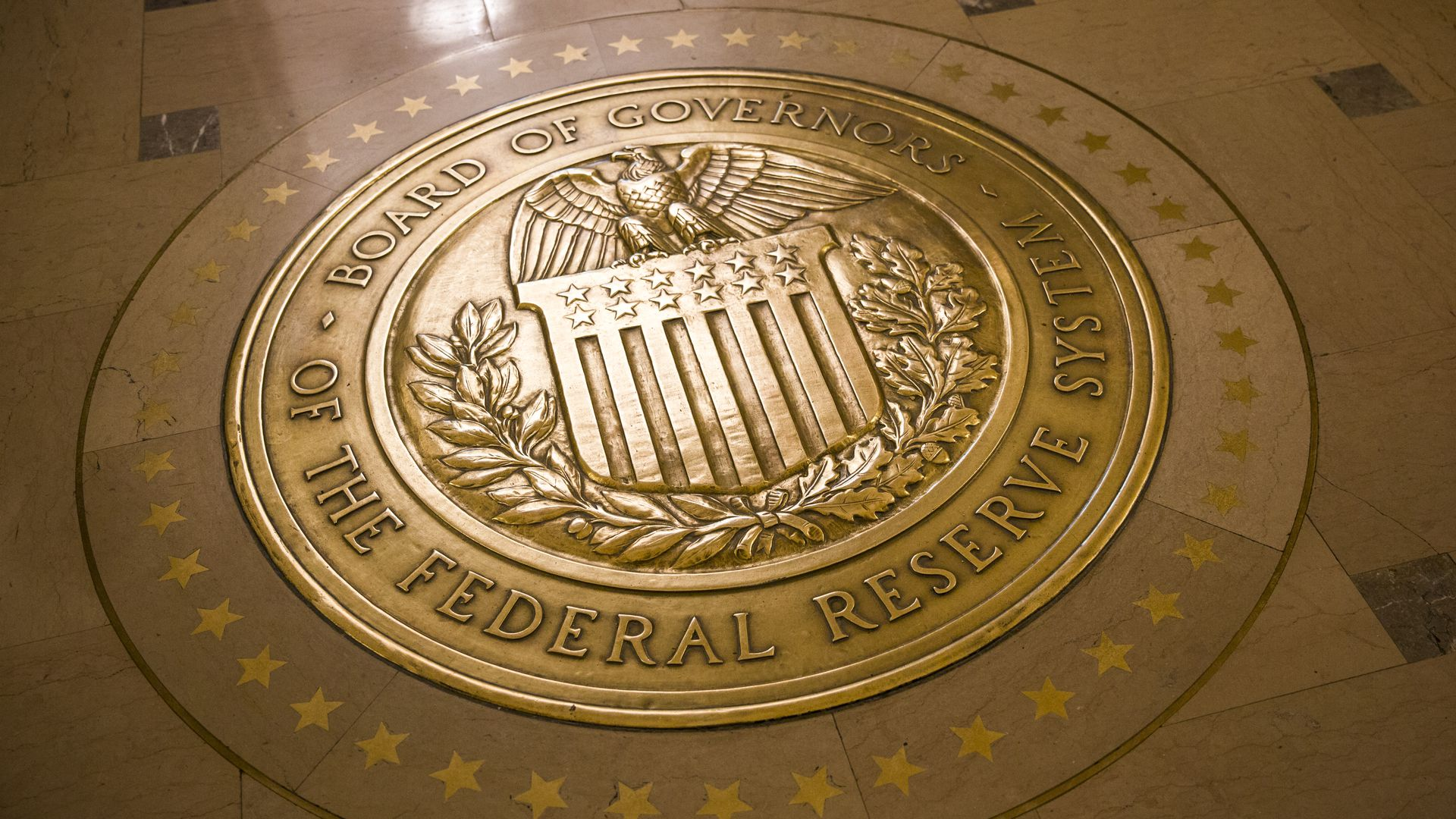 Gold-plated seal of the United States Federal Reserve.