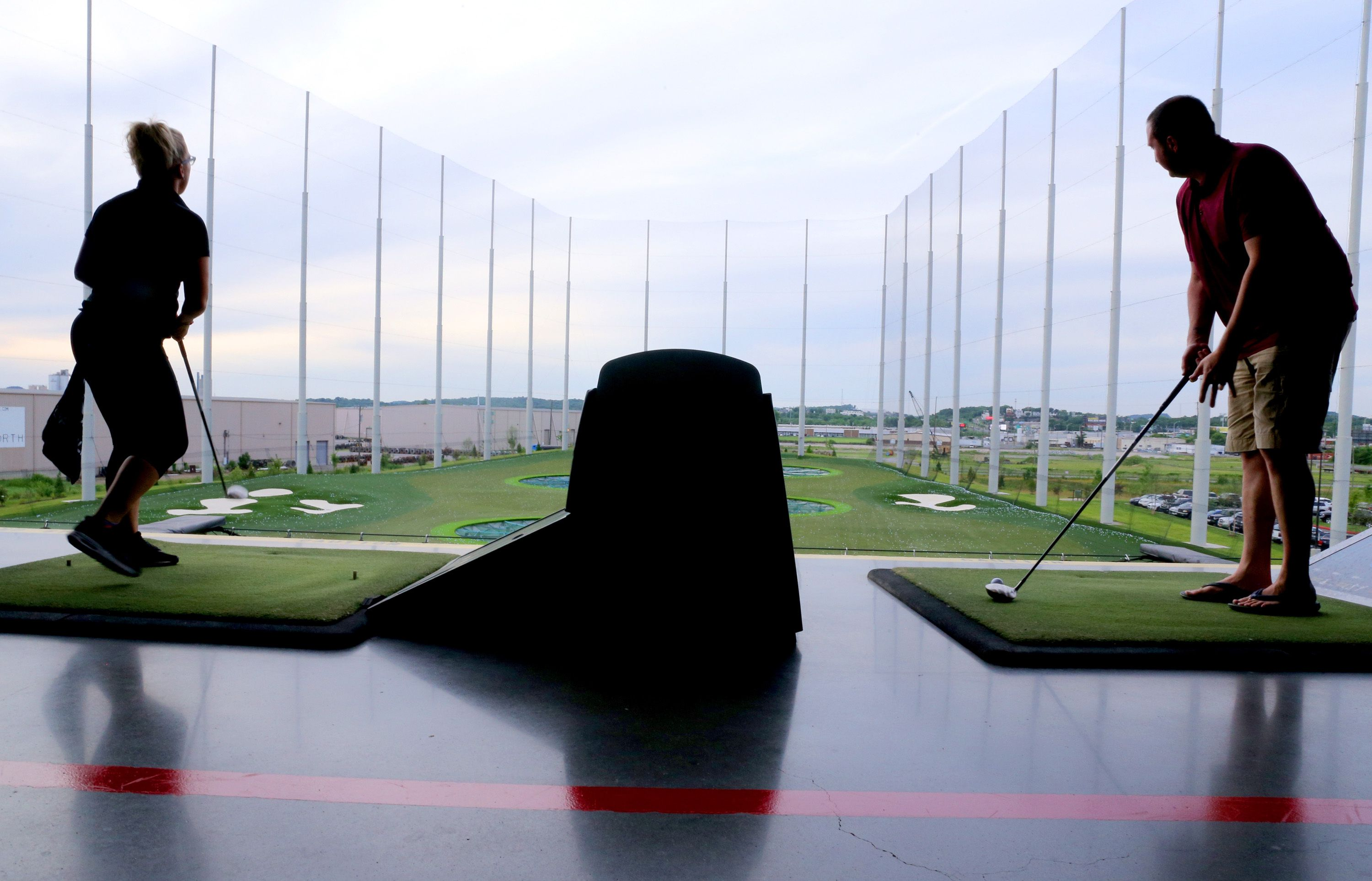 People golfing at a TopGolf location.