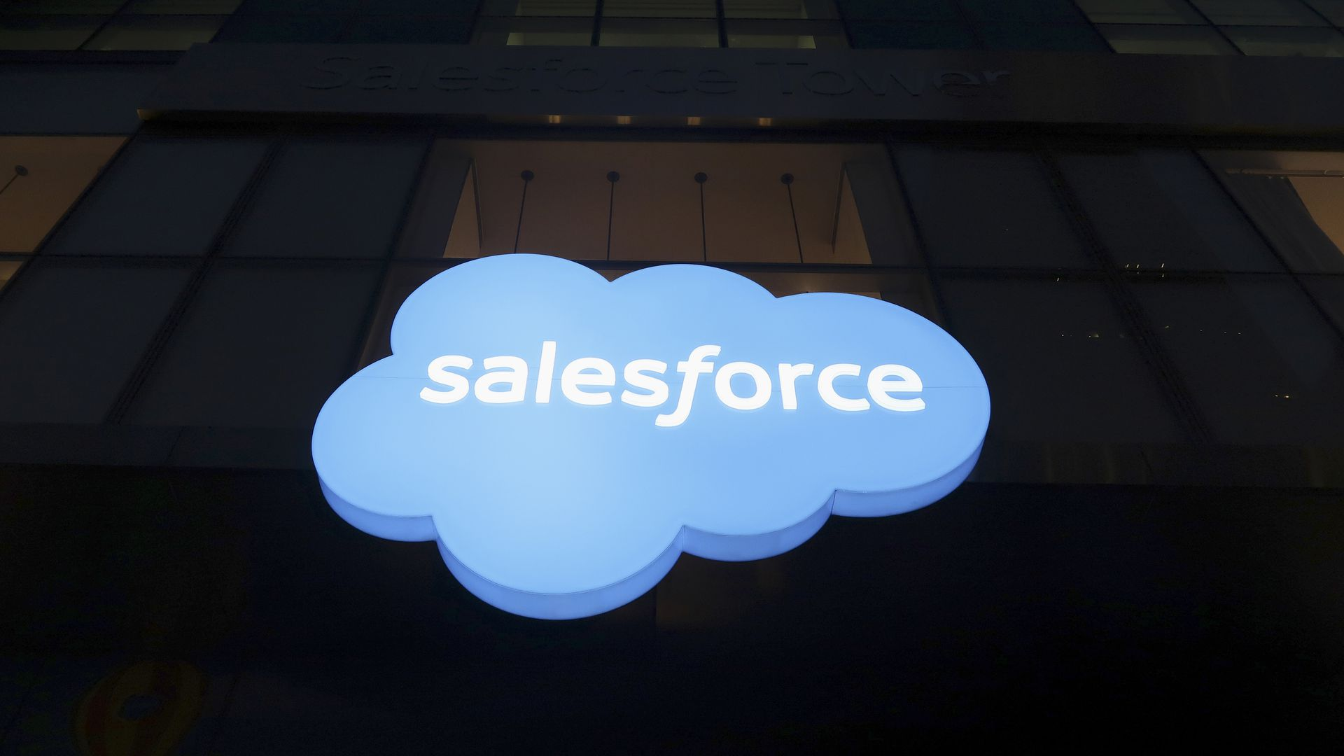 Photo of Salesforce logo on side of a dark building