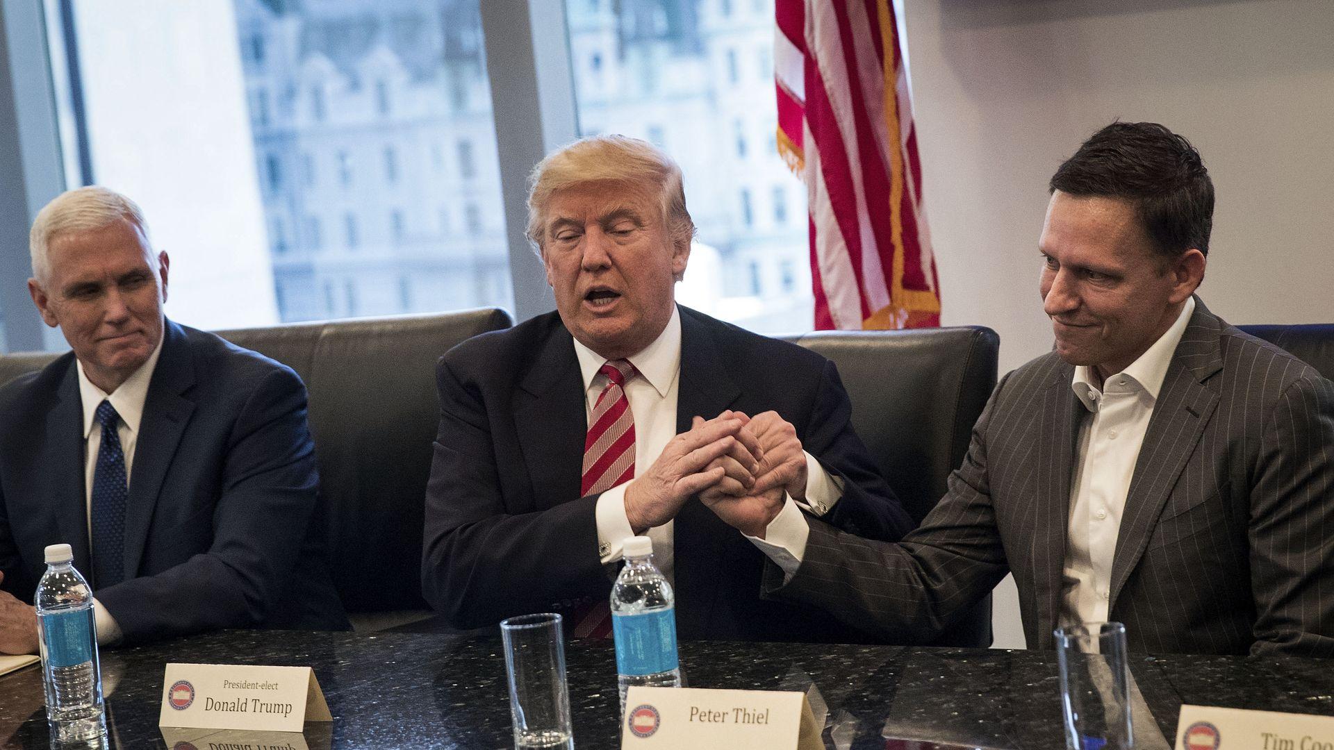 President Trump talking to Peter Thiel.