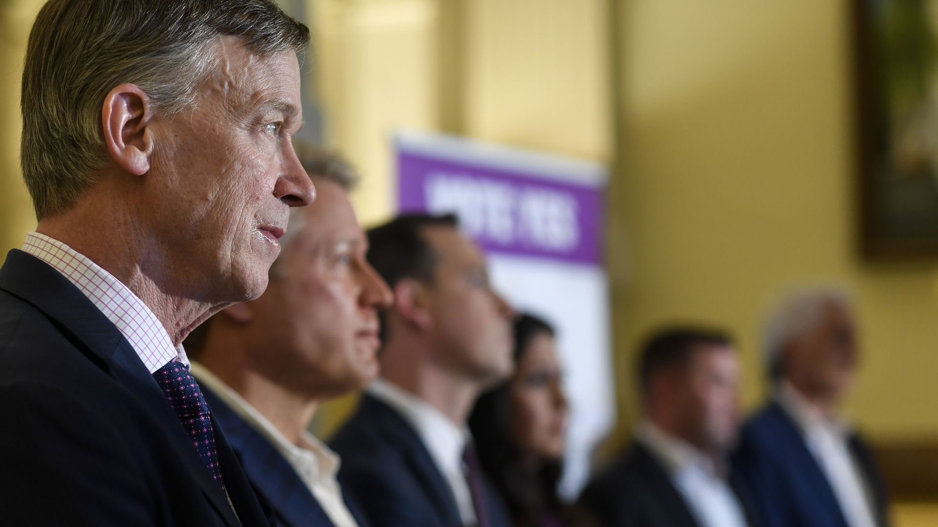 Kent Thiry, second from left, stands with former Gov. John Hickenlooper, far left, and state lawmakers. Photo: AAron Ontiveroz/The Denver Post via Getty Images
