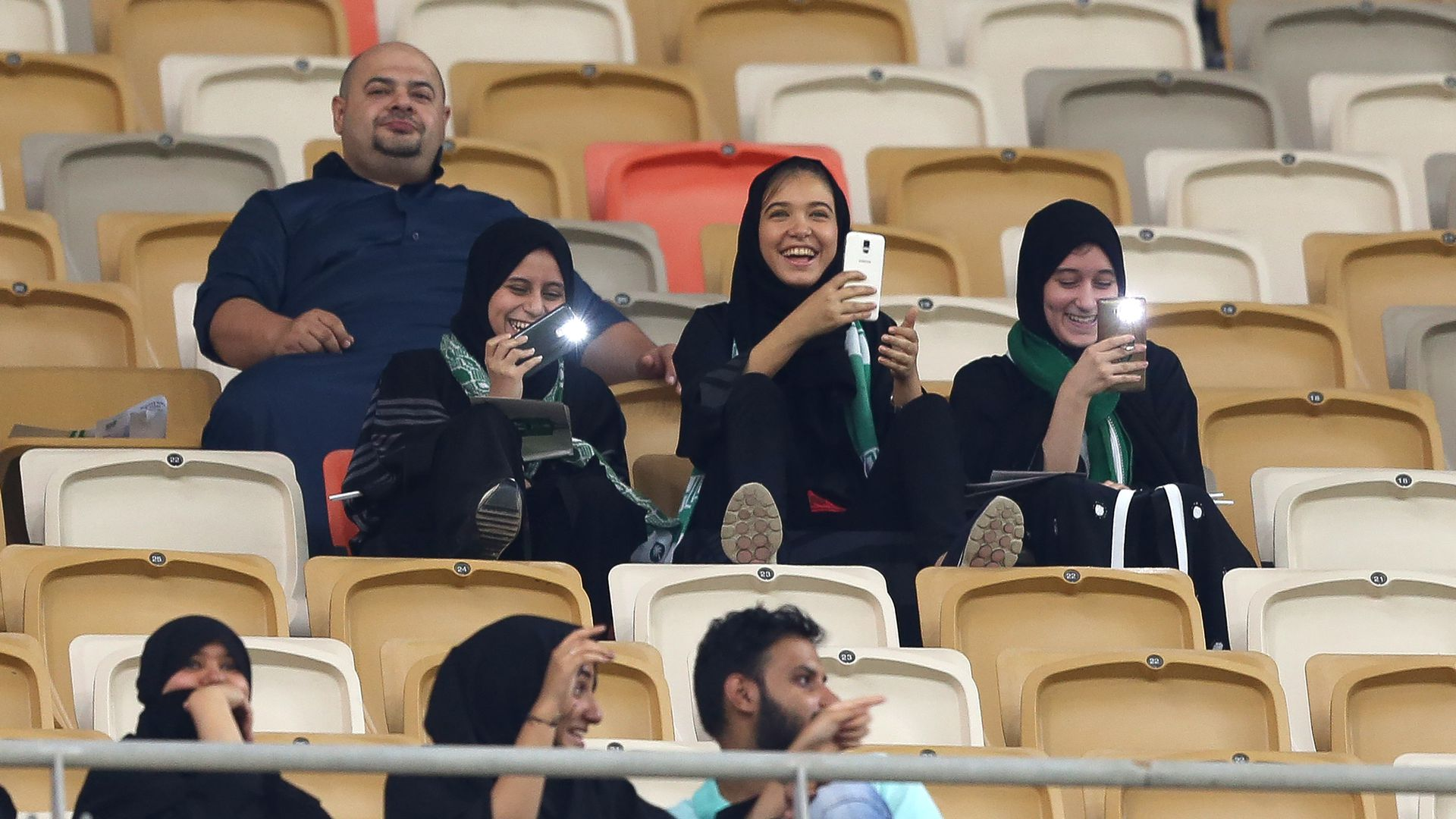 Female Saudi supporters attend their teams football match in the Saudi Pro League at the King Abdullah Sports City.