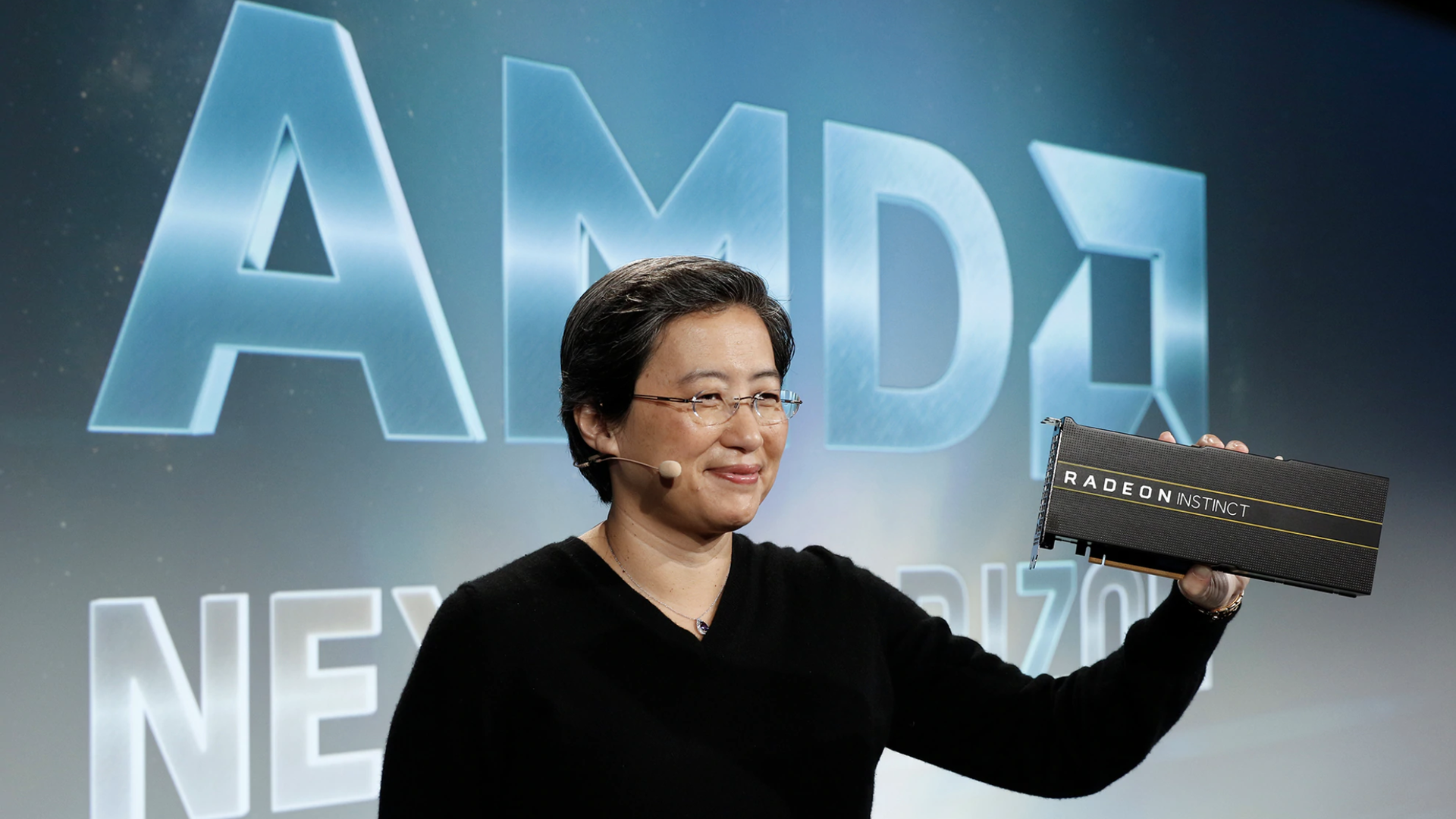 AMD CEO Lisa Su, holding up AMD's next-generation graphics chip for the data center.