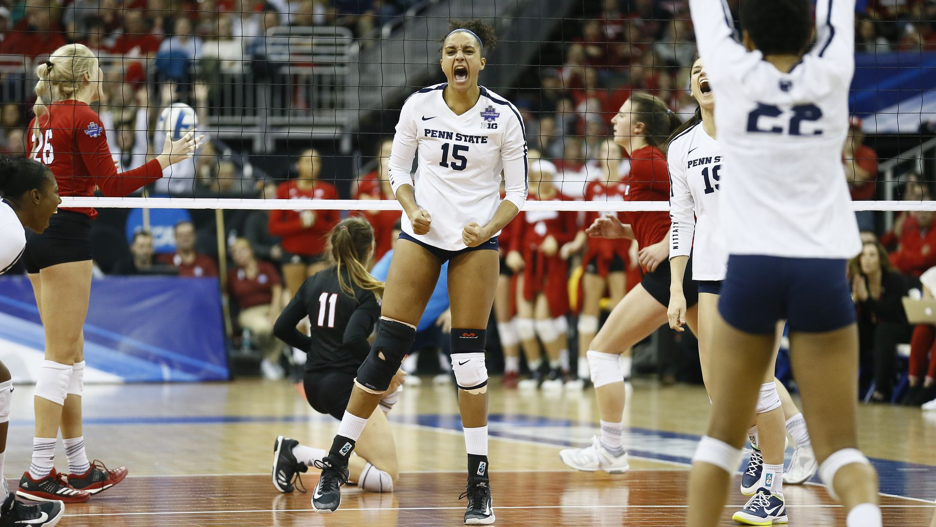 Volleyball player Haleigh Washington reacts in triumph to a play.