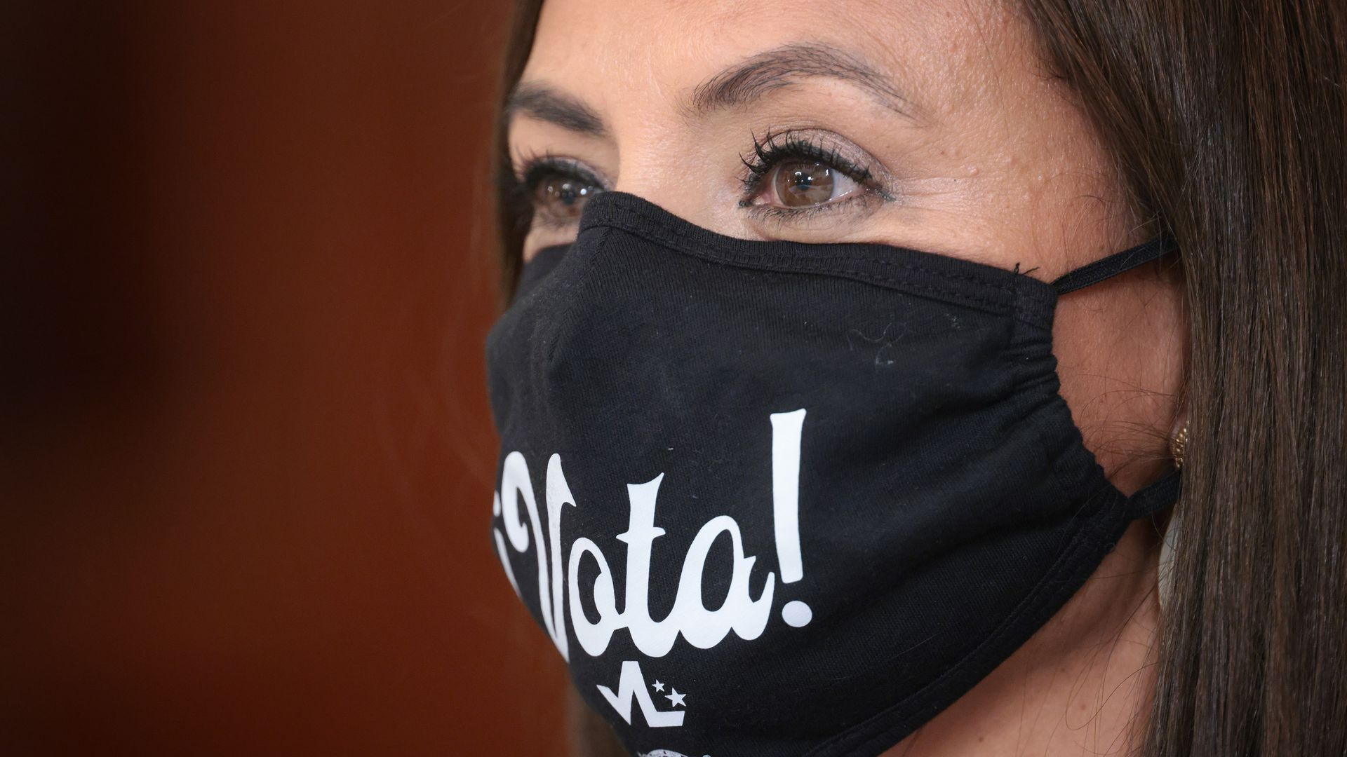 A person wears a Vota! facemask.