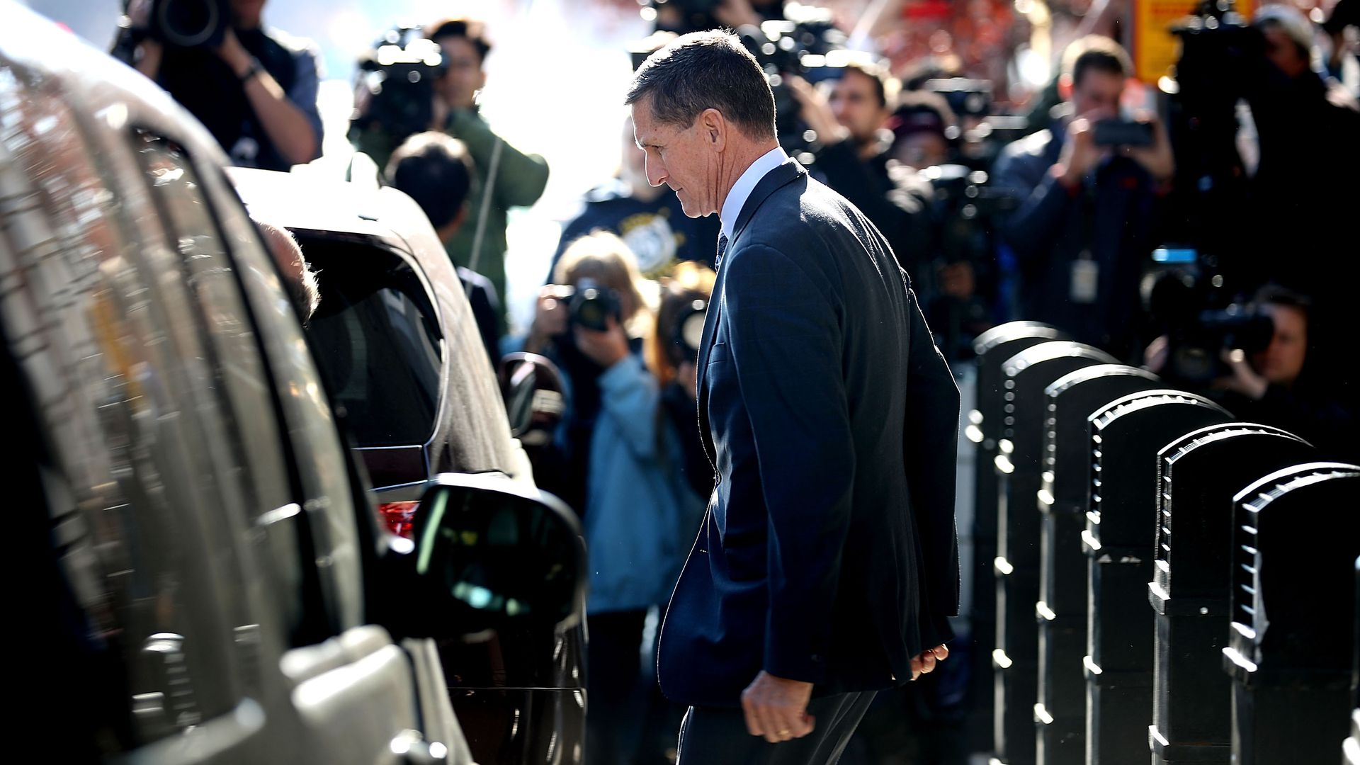 Michael Flynn, former national security advisor to President Donald Trump, leaves following his plea hearing